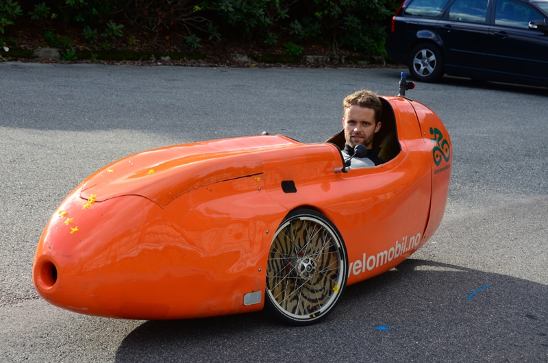 Man in velomobile