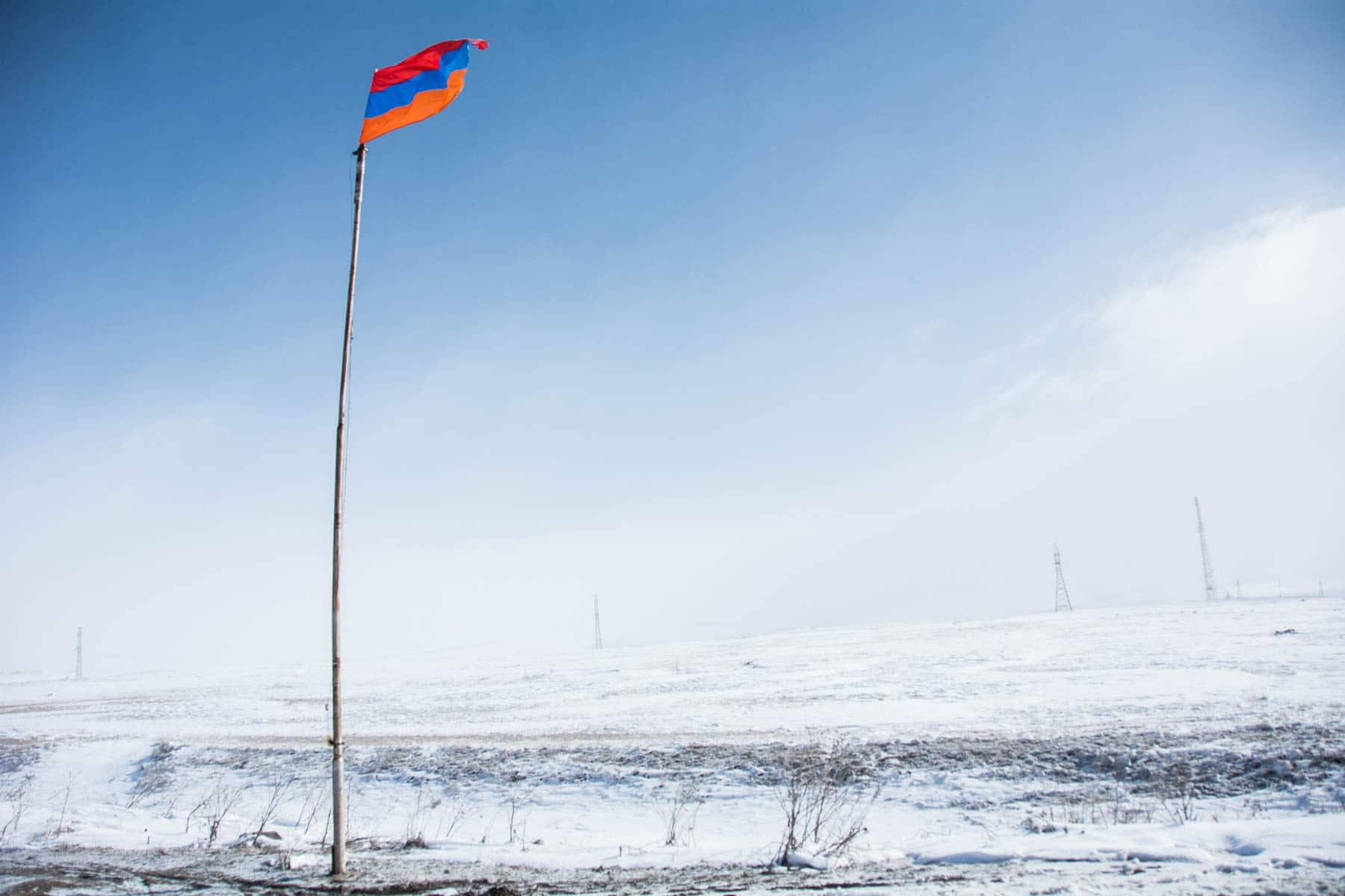 Armenian flag in winter at the Barza border crossing between Georgia and Armenia