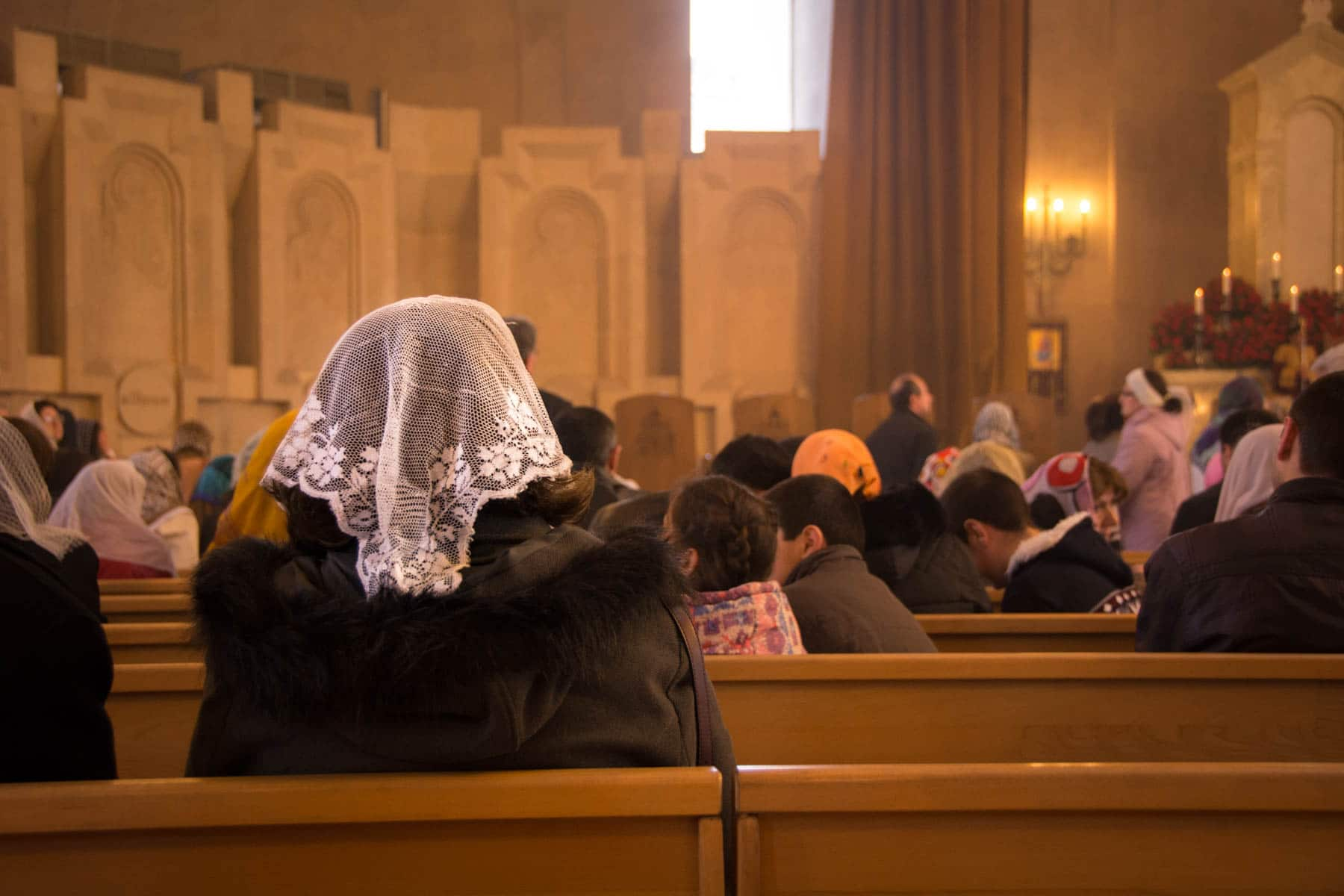 Easter in Armenia - A lace head scarf on a woman at Easter mass in Yerevan, Armenia