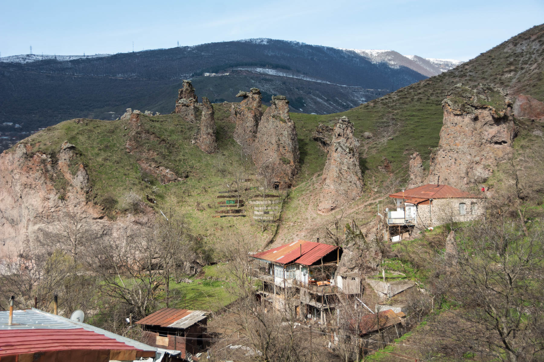 How to get to Tatev from Goris, Armenia - Houses built next to caves in the rocky spires of Goris, Armenia