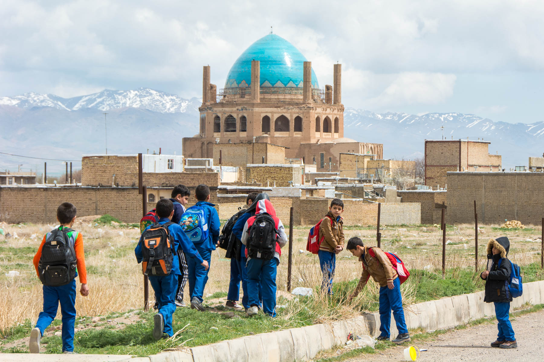 Children playing in front of Soltaniyeh dome in Soltaniyeh, Iran