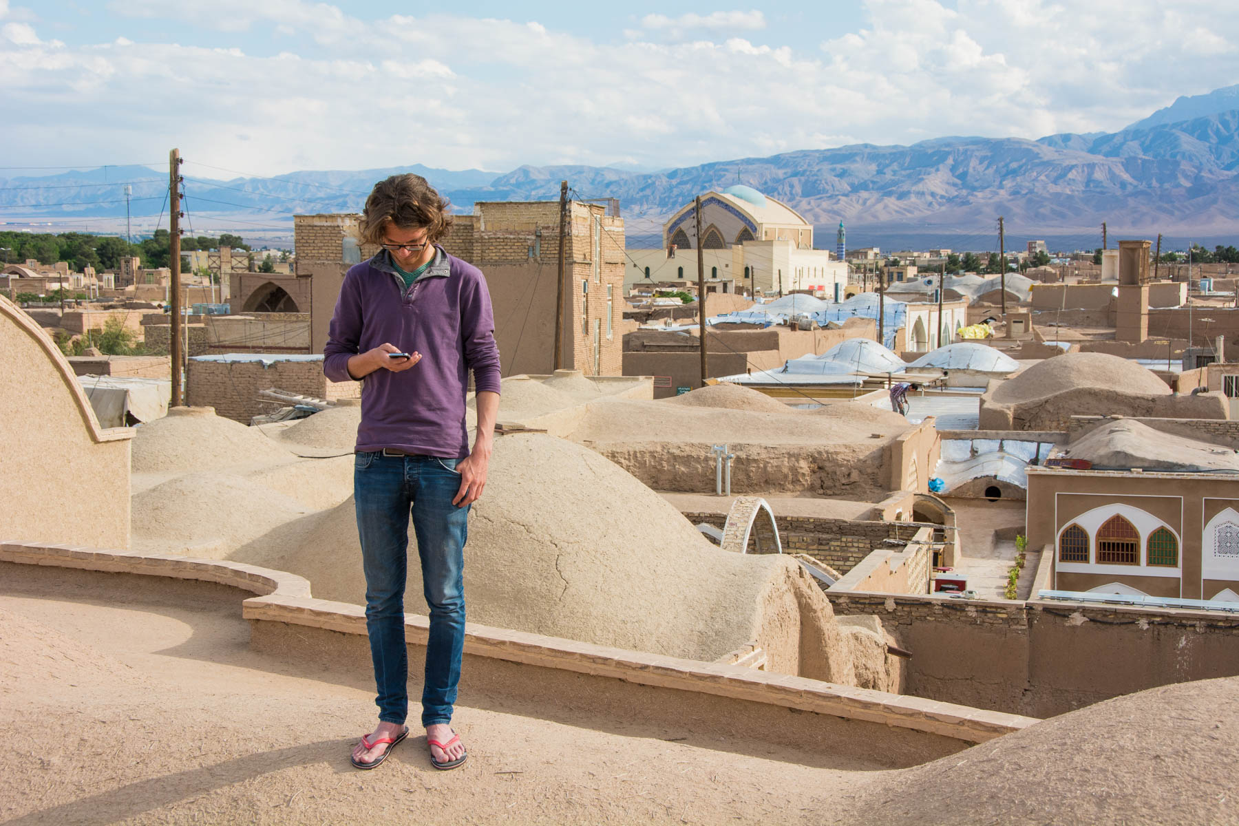 Addicted to phones on the rooftops of Kashan, Iran