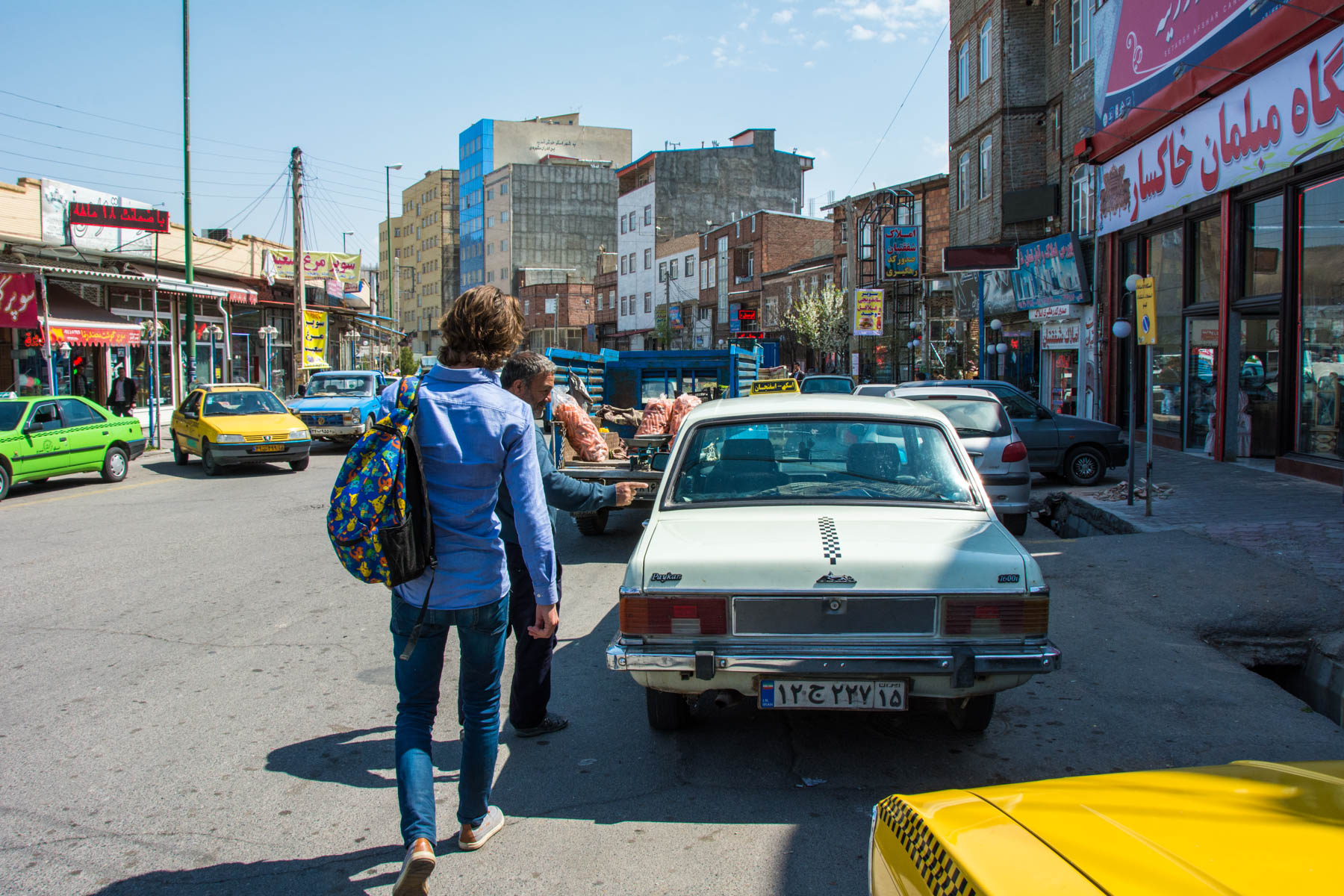 Taking a private taxi on the way to Kandovan in Iran