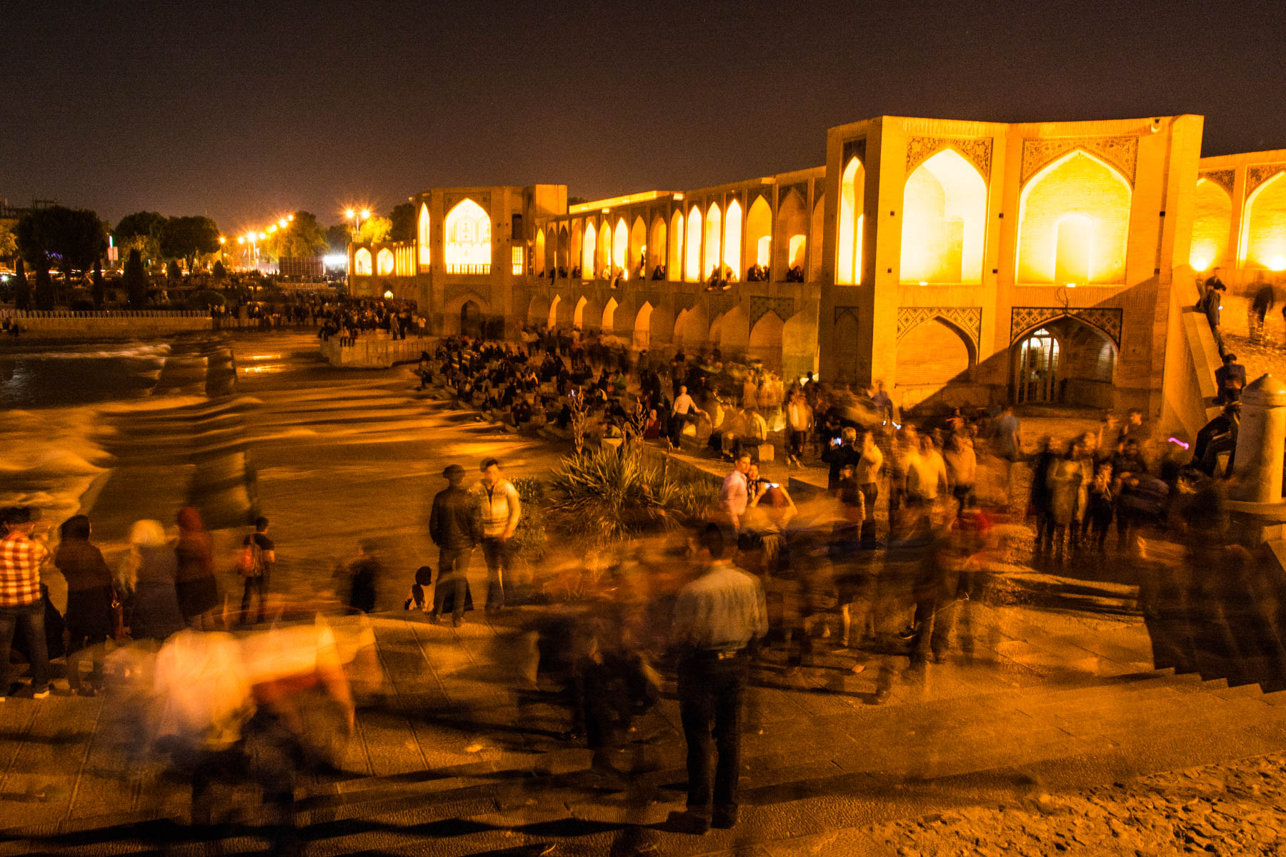 The Pol-e Khaju bridge in Isfahan teeming with life on a warm spring evening.