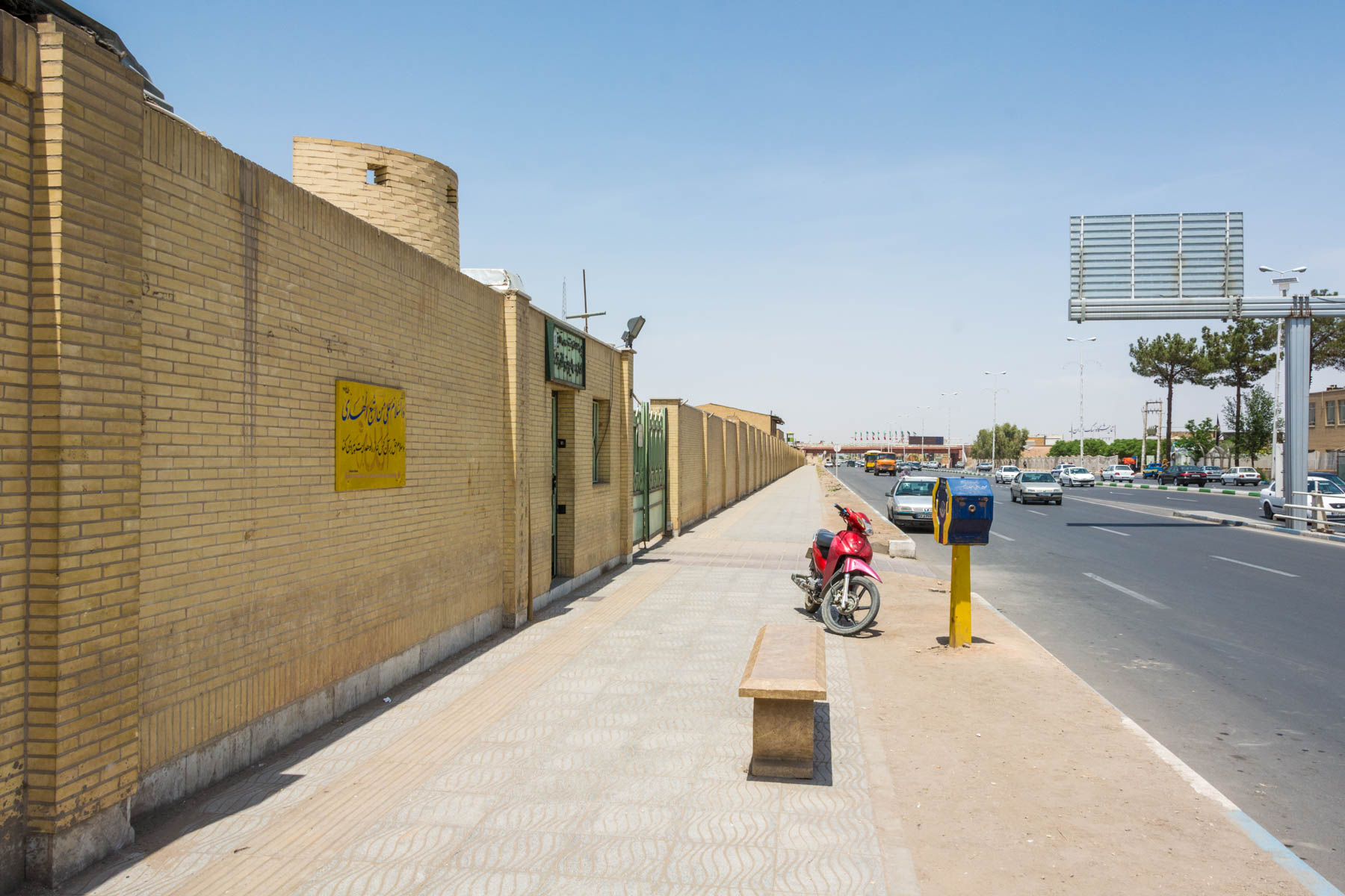 The yellow brick wall along Kashani street, where the Passport and Alien Affairs office is located for getting an Iran visa extension in Yazd.