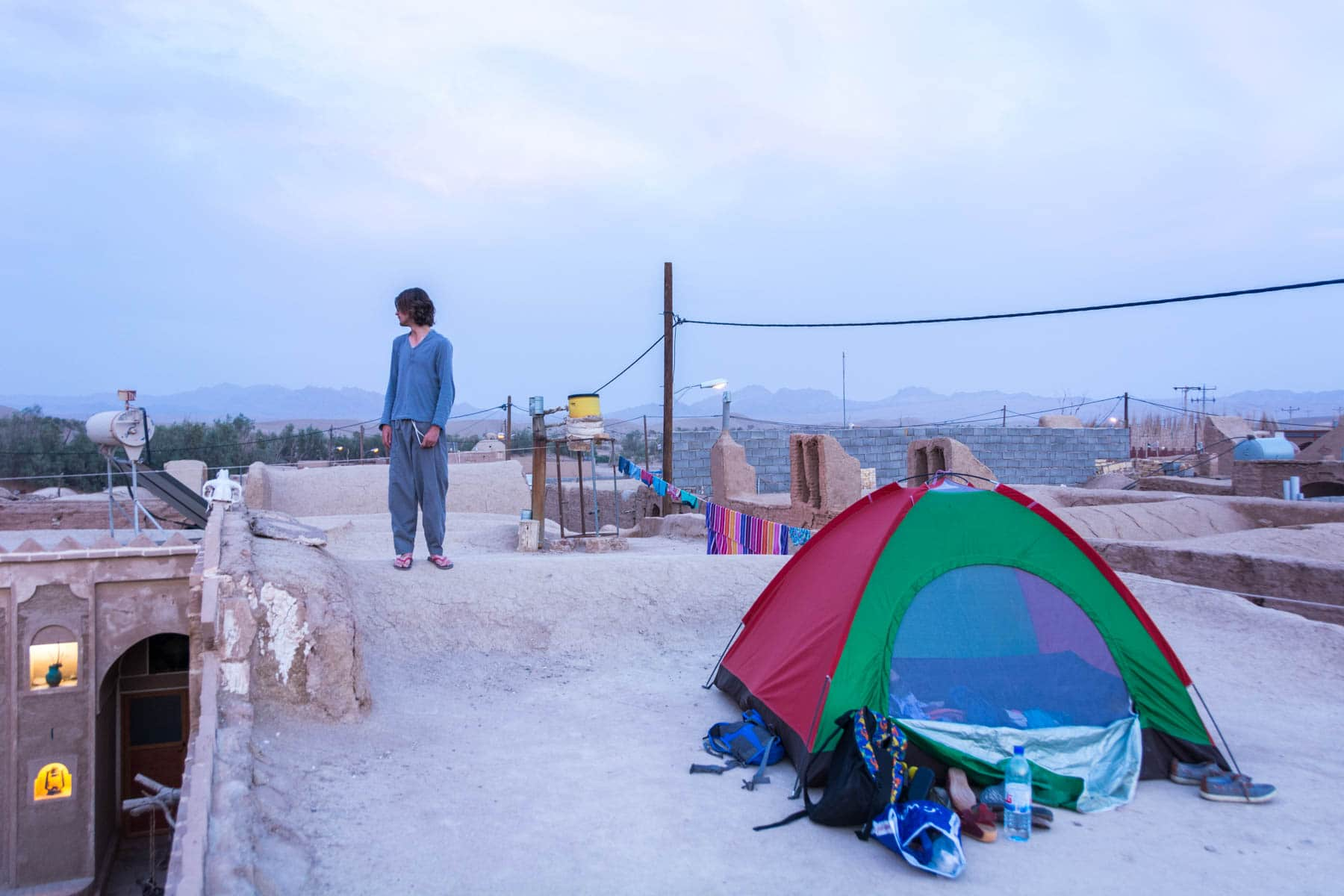 Camping on the roof of Barandaz Lodge in the desert town of Farahzad, Iran