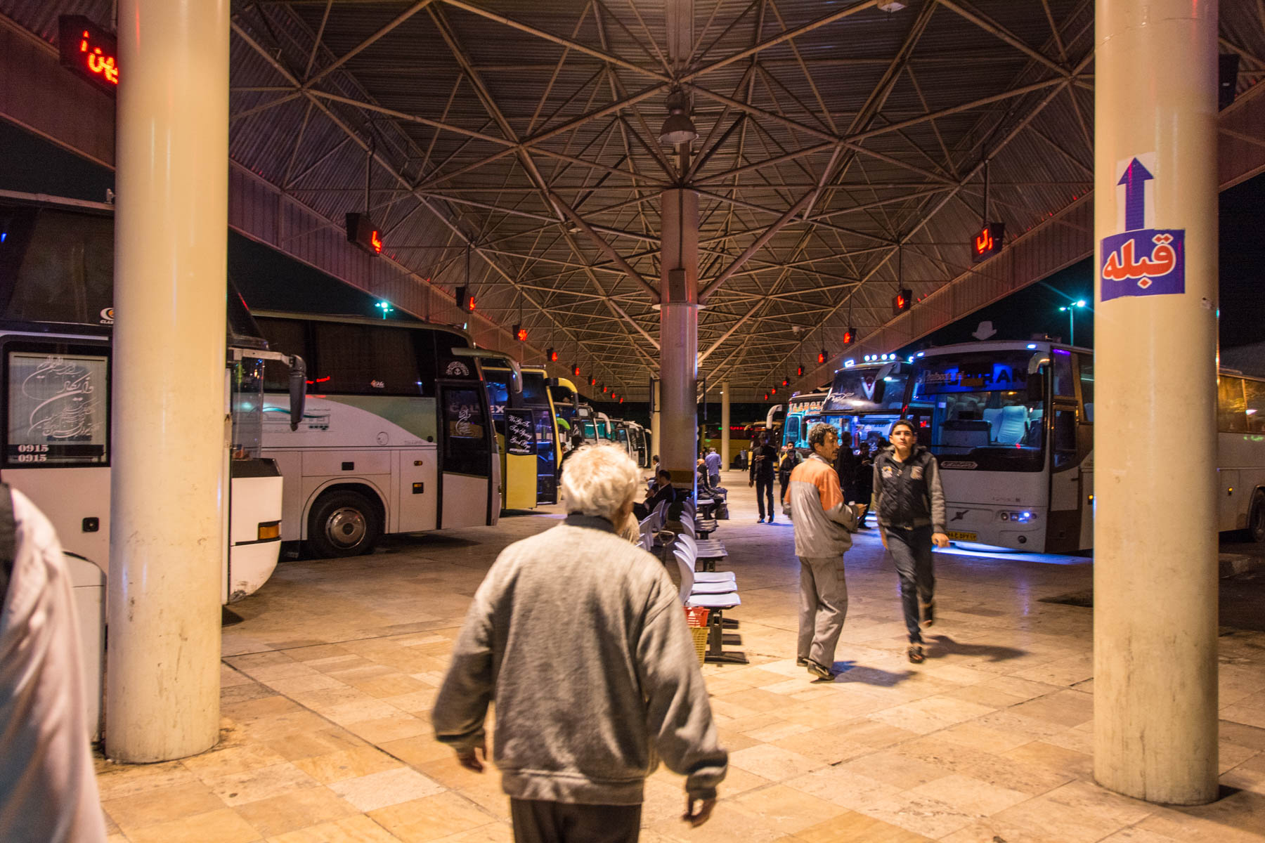 The bus terminal of Mashhad, Iran at night.