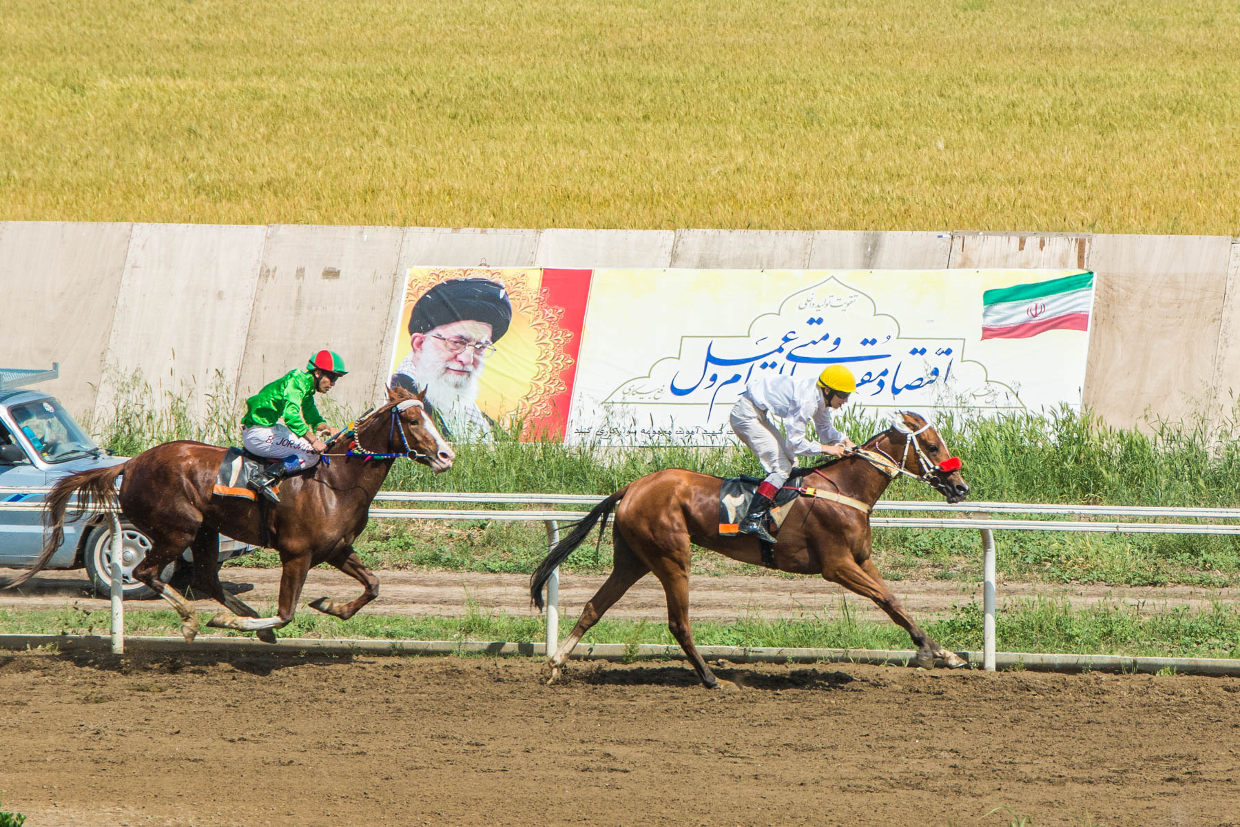 Riders finishing a race at the horse races in Gonbad-e Kavus, Iran.