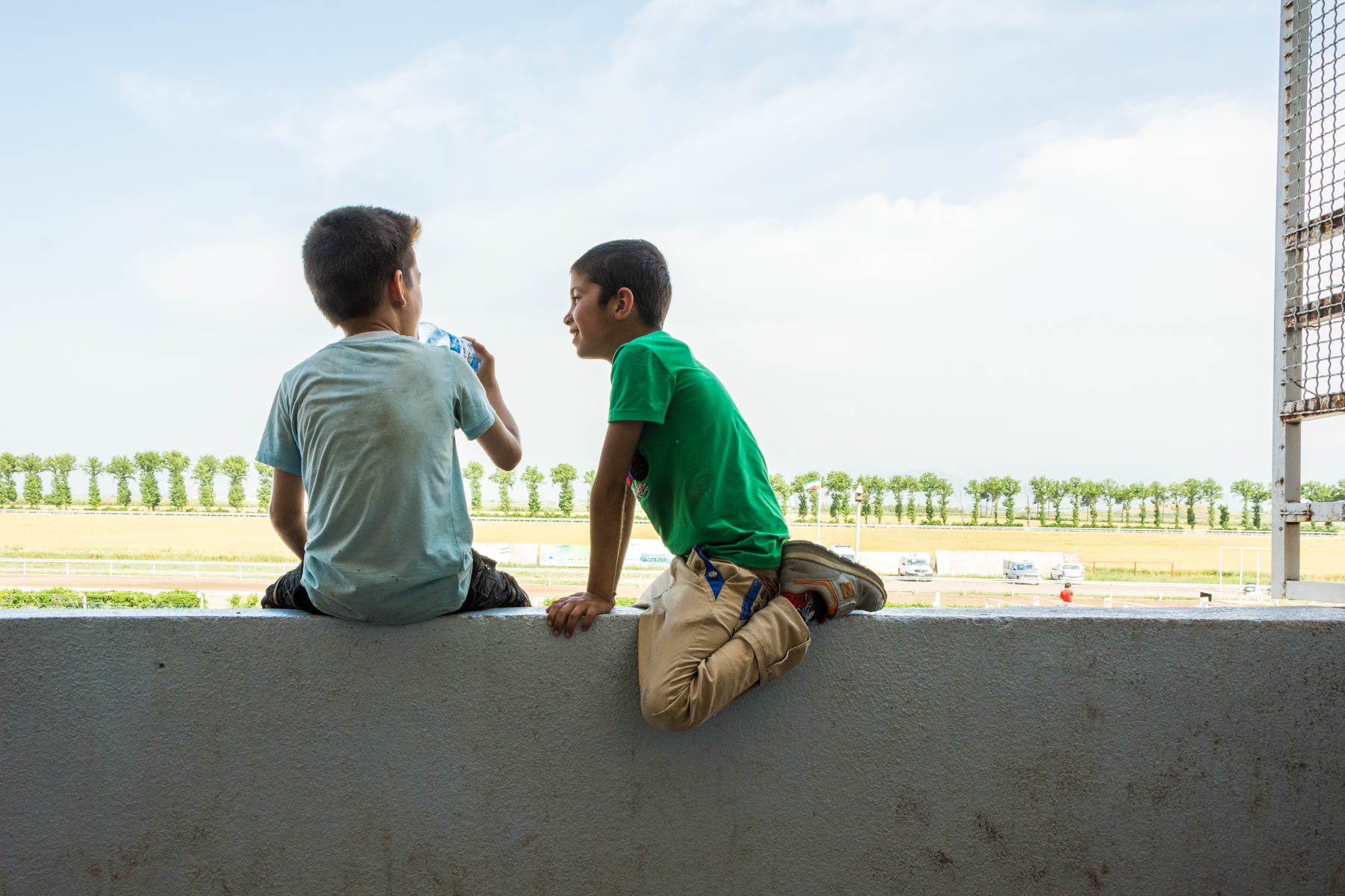 Young boys watching the horse races in Gonbad-e Kavus, Iran