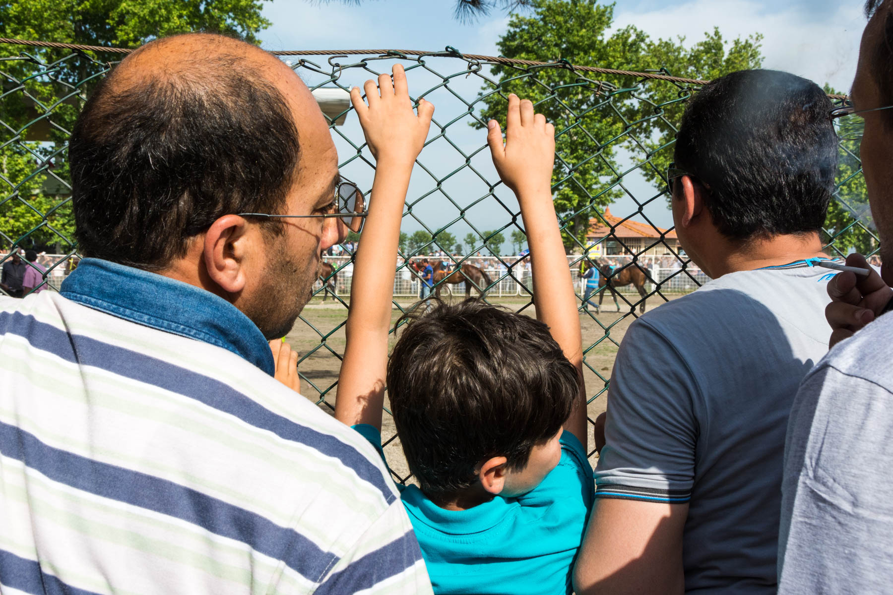 A boy watching the horses at the races in Gonbad Kavus, Iran