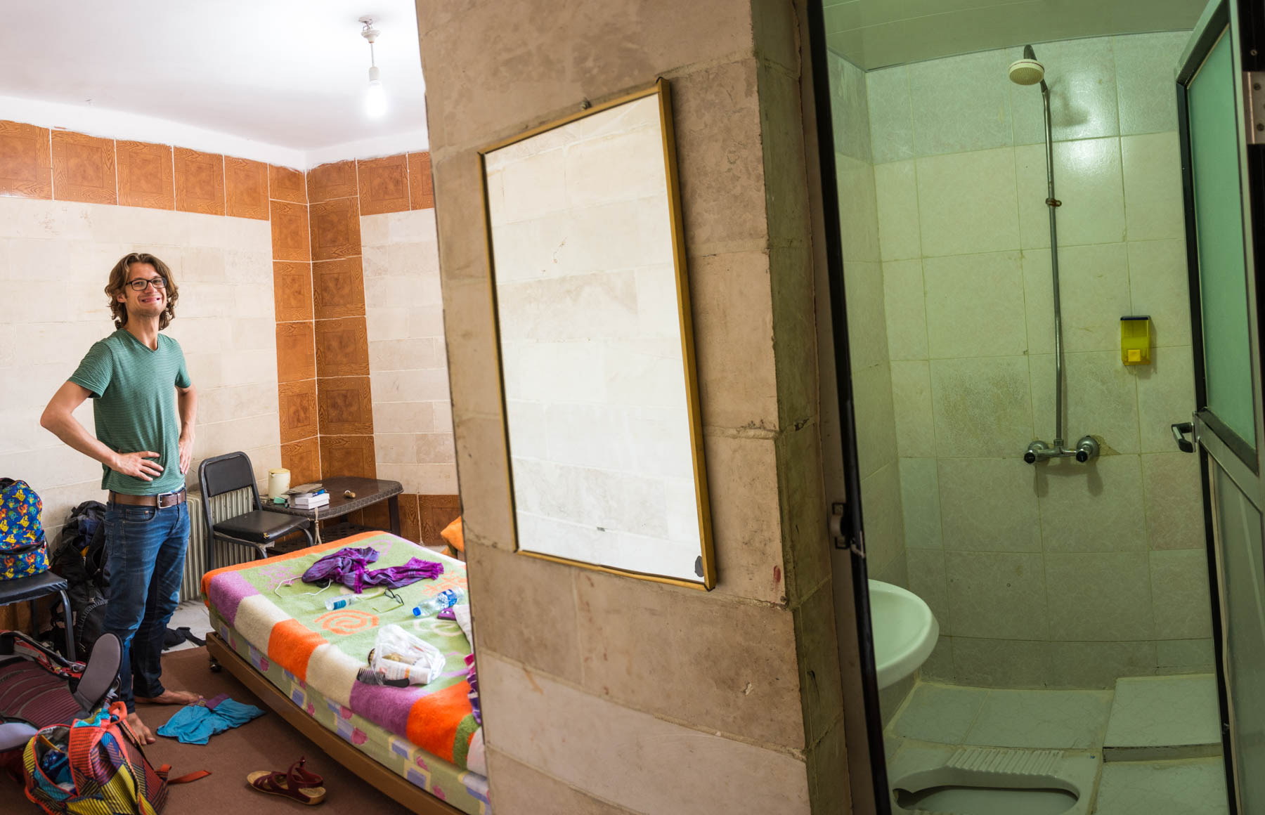 I'm foreign, so I must be rich: that's why I stayed in this grubby cheap hotel room in Sanandaj, Iran.