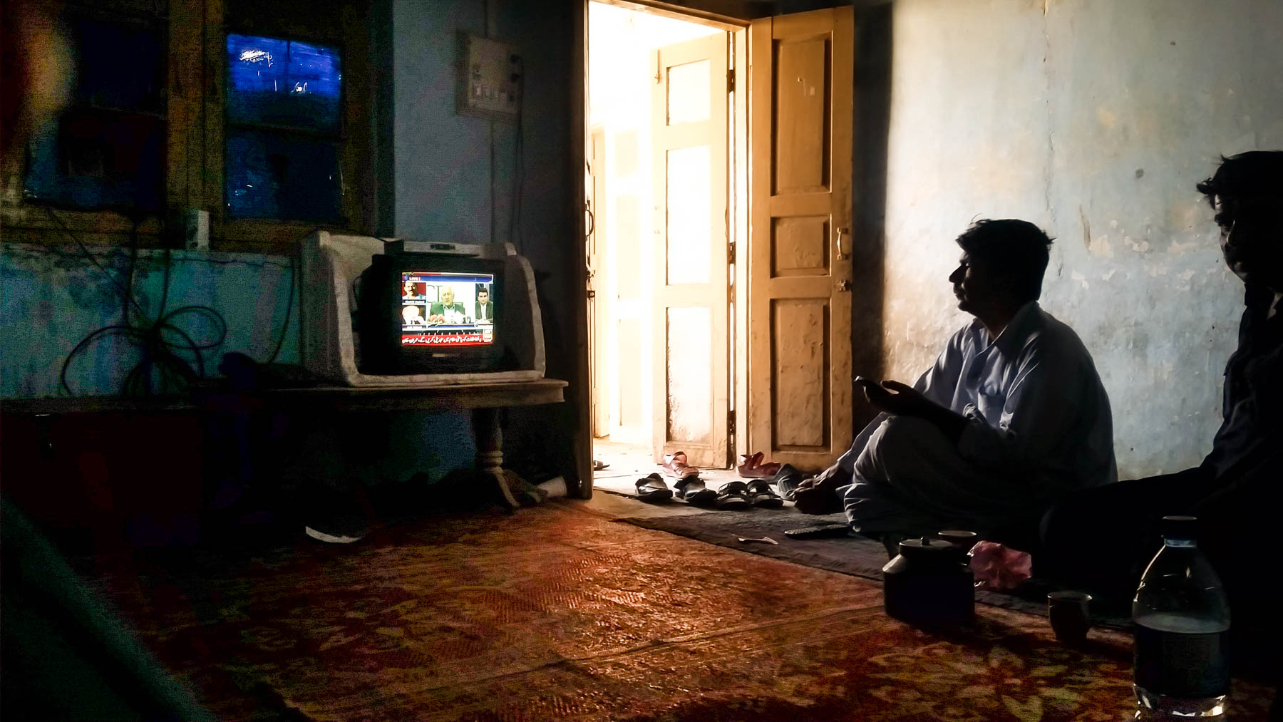 Watching TV in the Levies station common room in Taftan, Pakistan