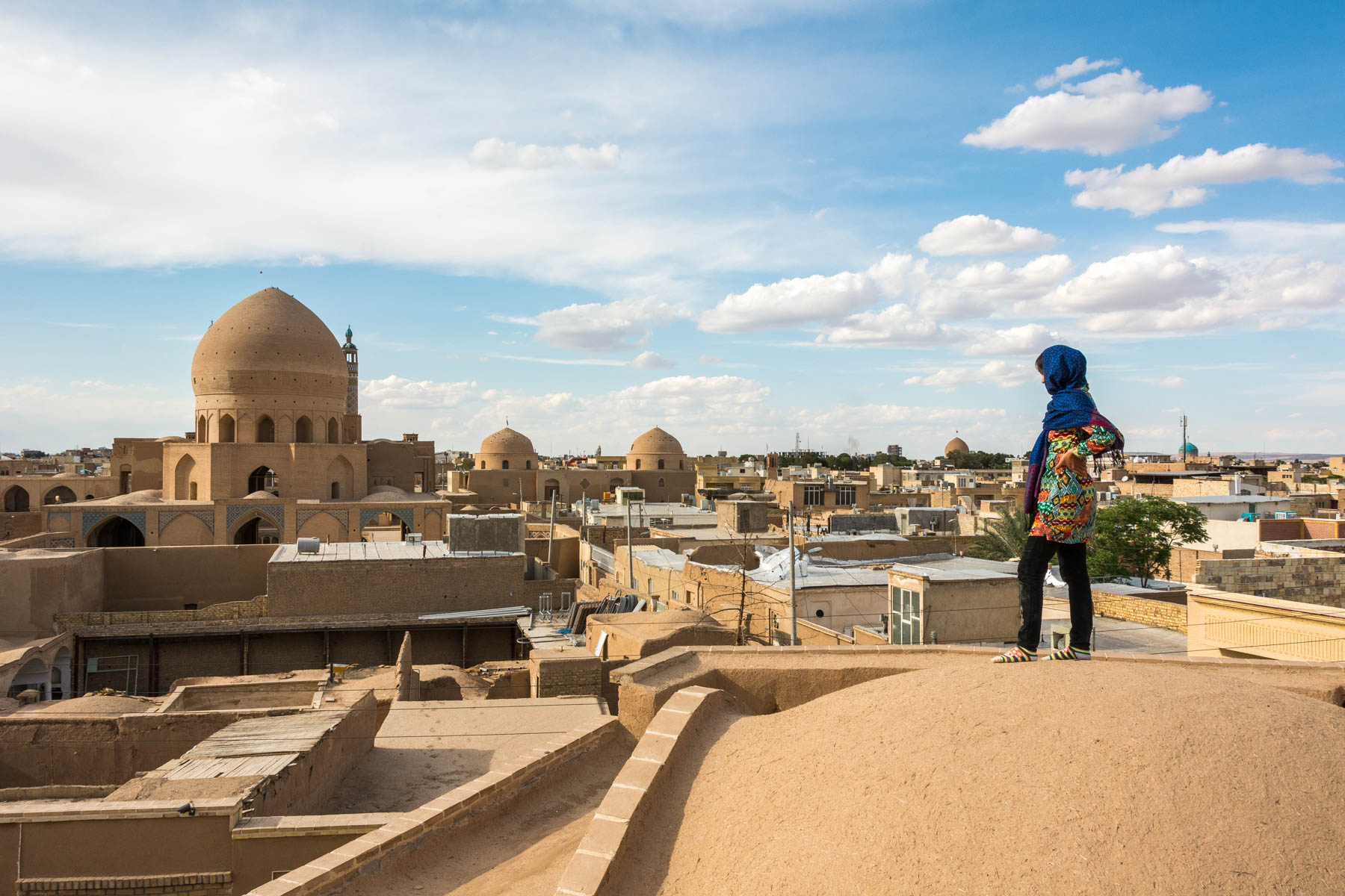 Things to know before traveling in Iran: how women need to dress and act. Surveying the skyline in Kashan, Iran.