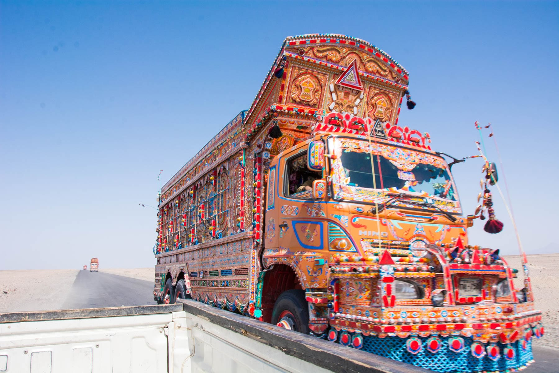 A decorated truck driving through Balochistan province, Pakistan.