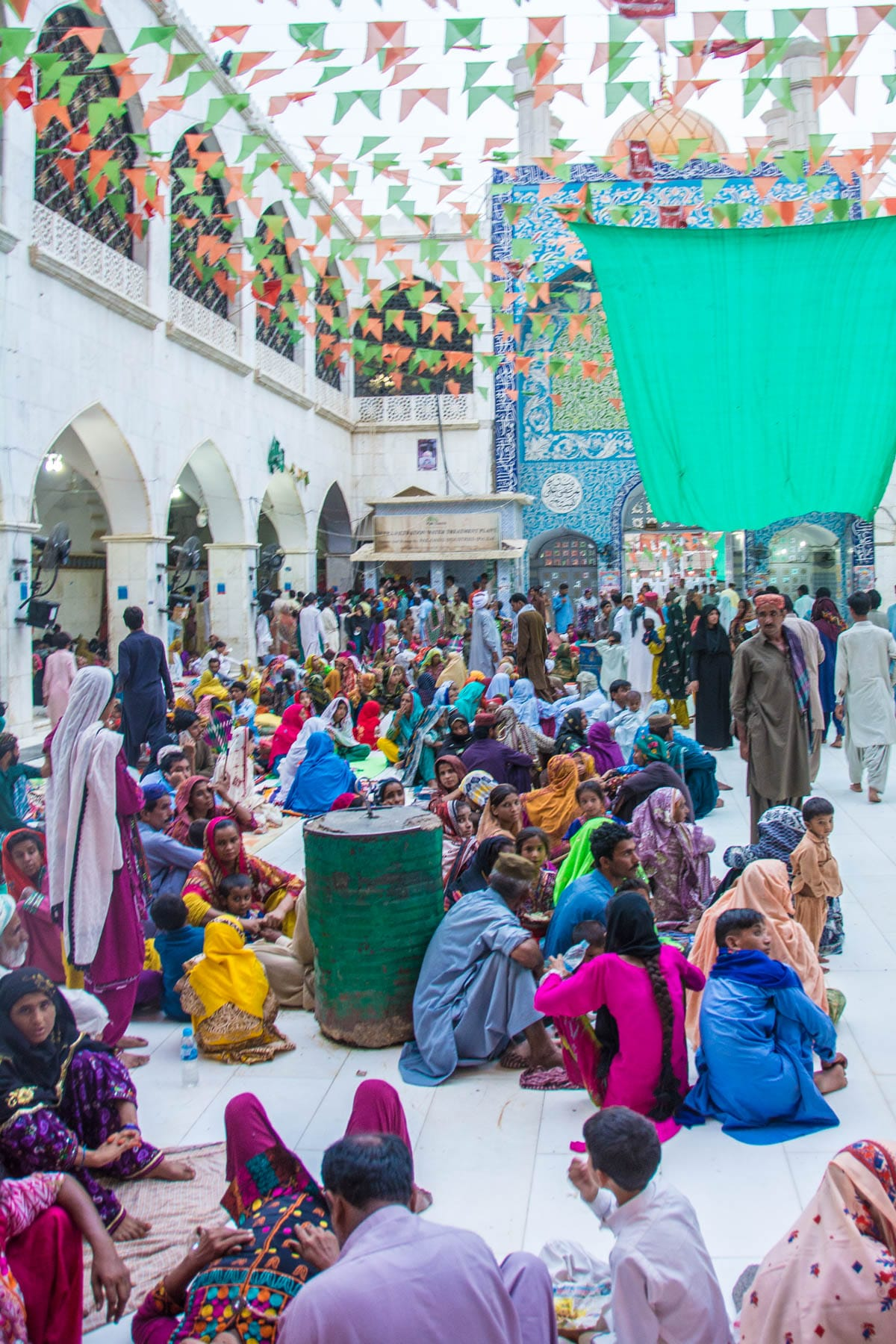 People gathering for iftar during Ramadan at the Lal Shahbaz Qalandar shrine in Sehwan, Pakistan