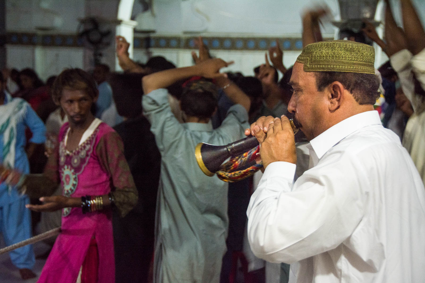 A horn player at the Lal Shahbaz Qalandar shrine in Sehwan, Iran