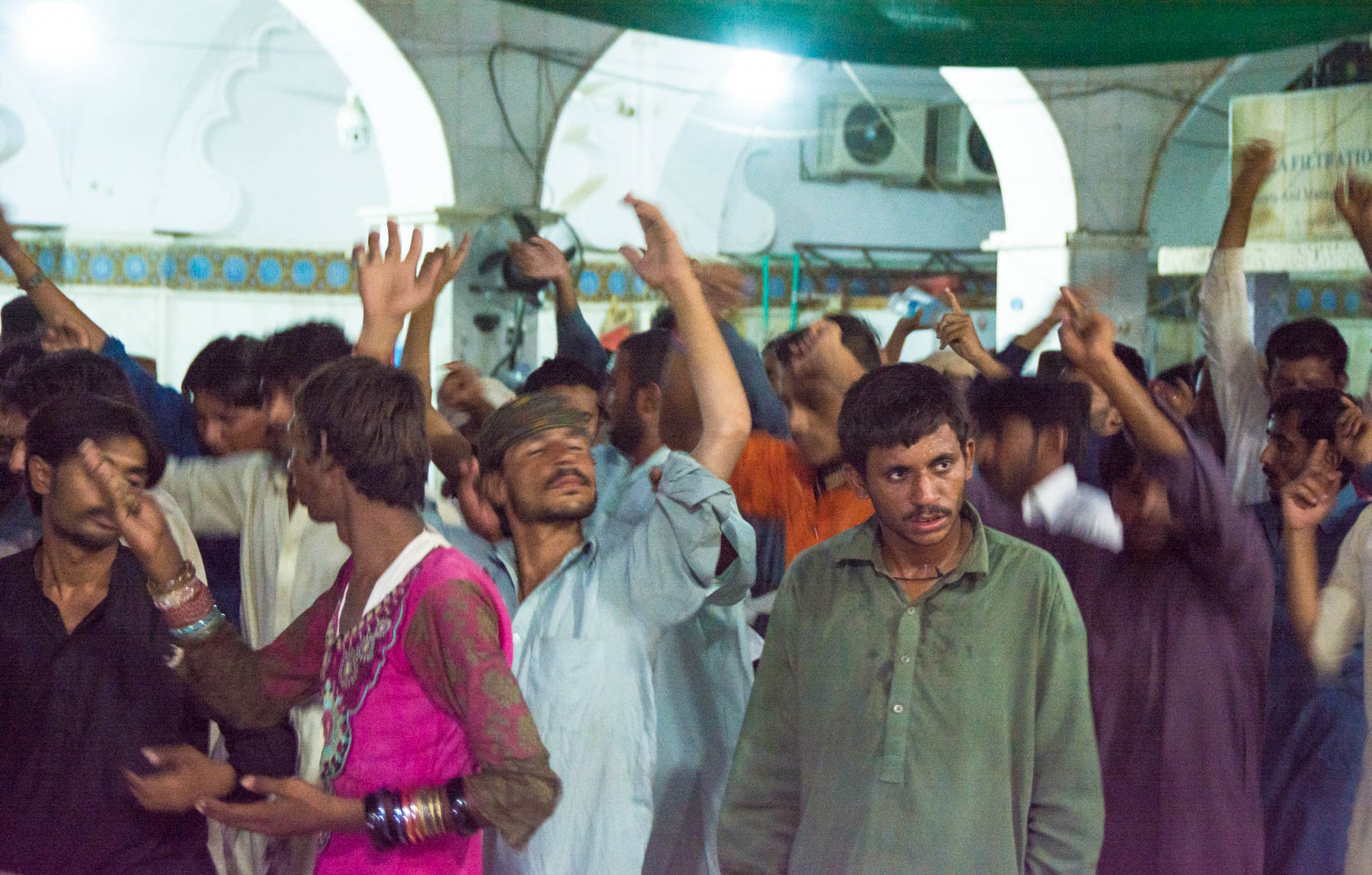 Entranced Sufi dancers during Ramadan at the Lal Shahbaz Qalandar shrine in Sehwan, Pakistan