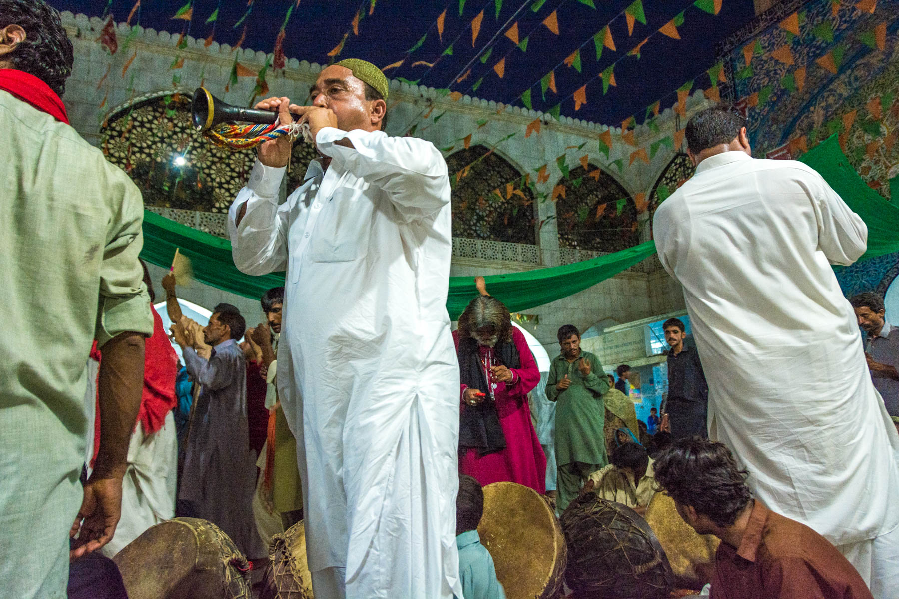 A horn player during sufi dancing at the Lal Shahbaz Qalandar shrine in Sehwan, Pakistan
