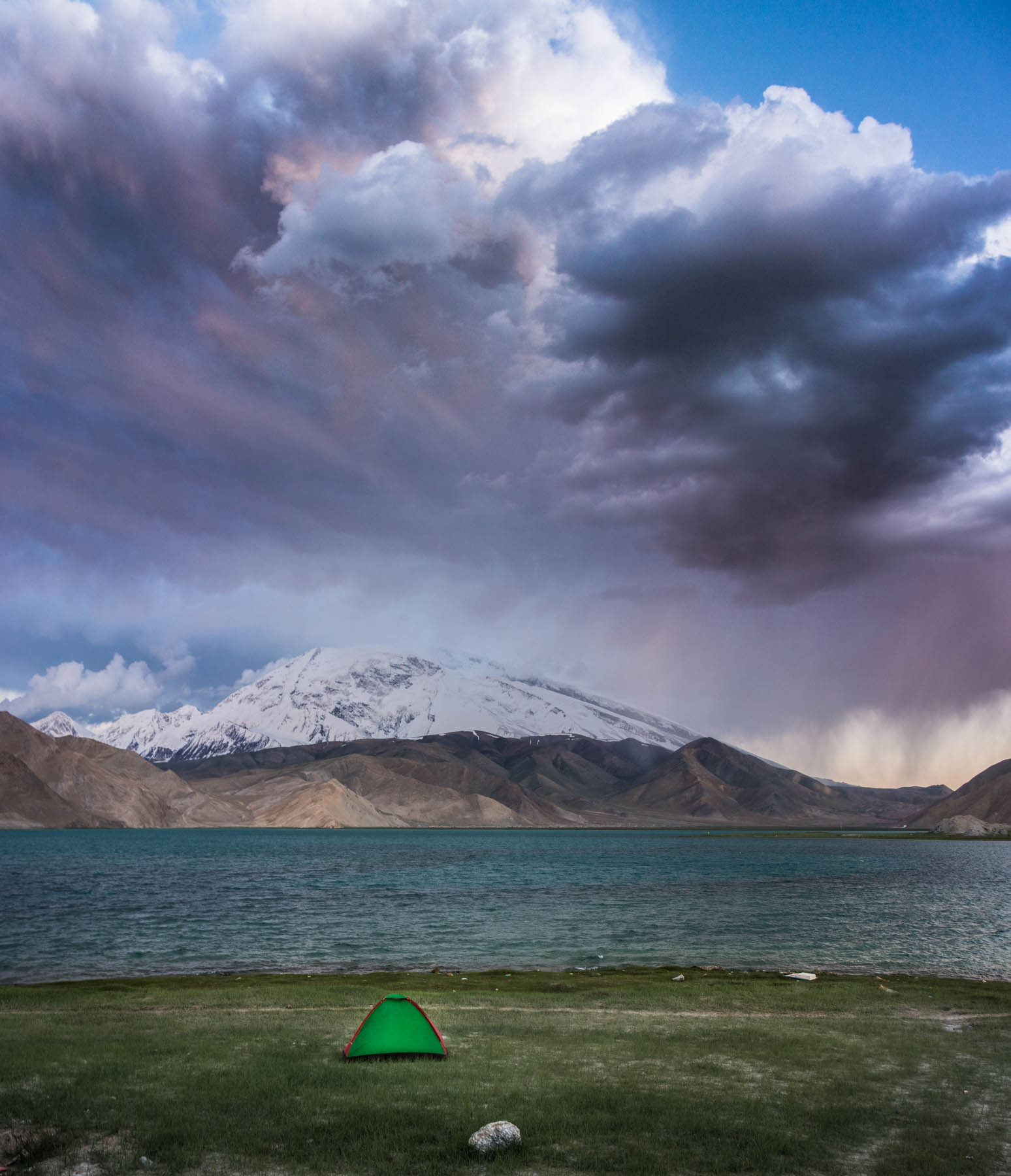 Our teeny tent about to be ravaged by the elements at Karakul Lake in China.