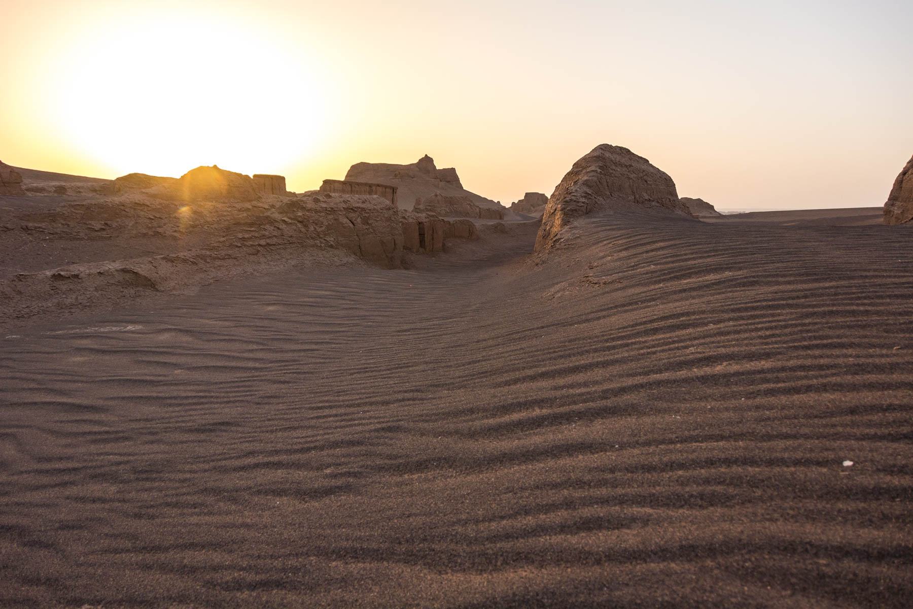 Waves of sand and stone in the Kaluts desert in Iran