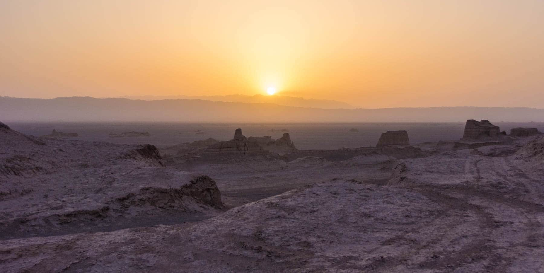 The sun setting over the Kaluts in Iran