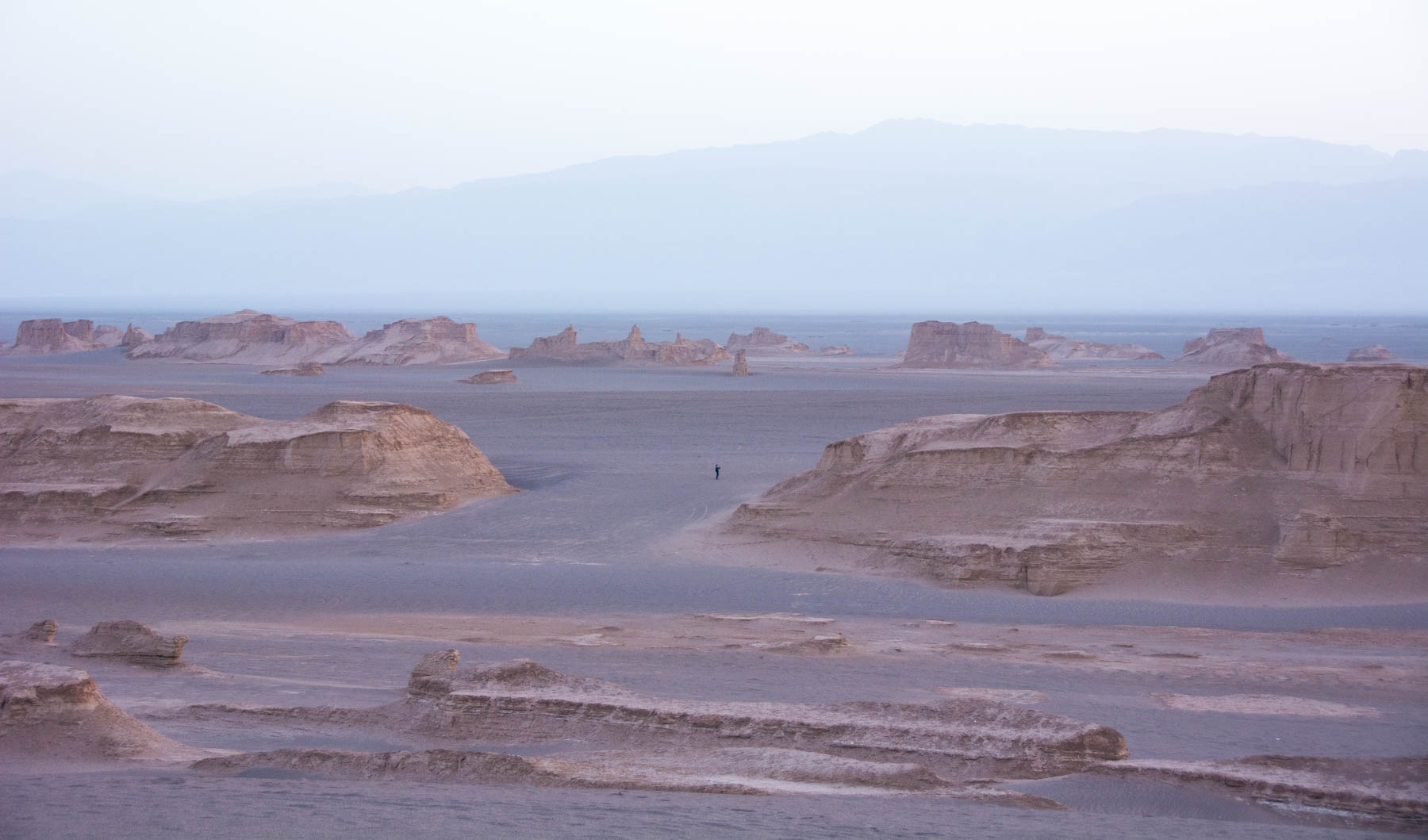 A man wandering around in the Kaluts of Iran