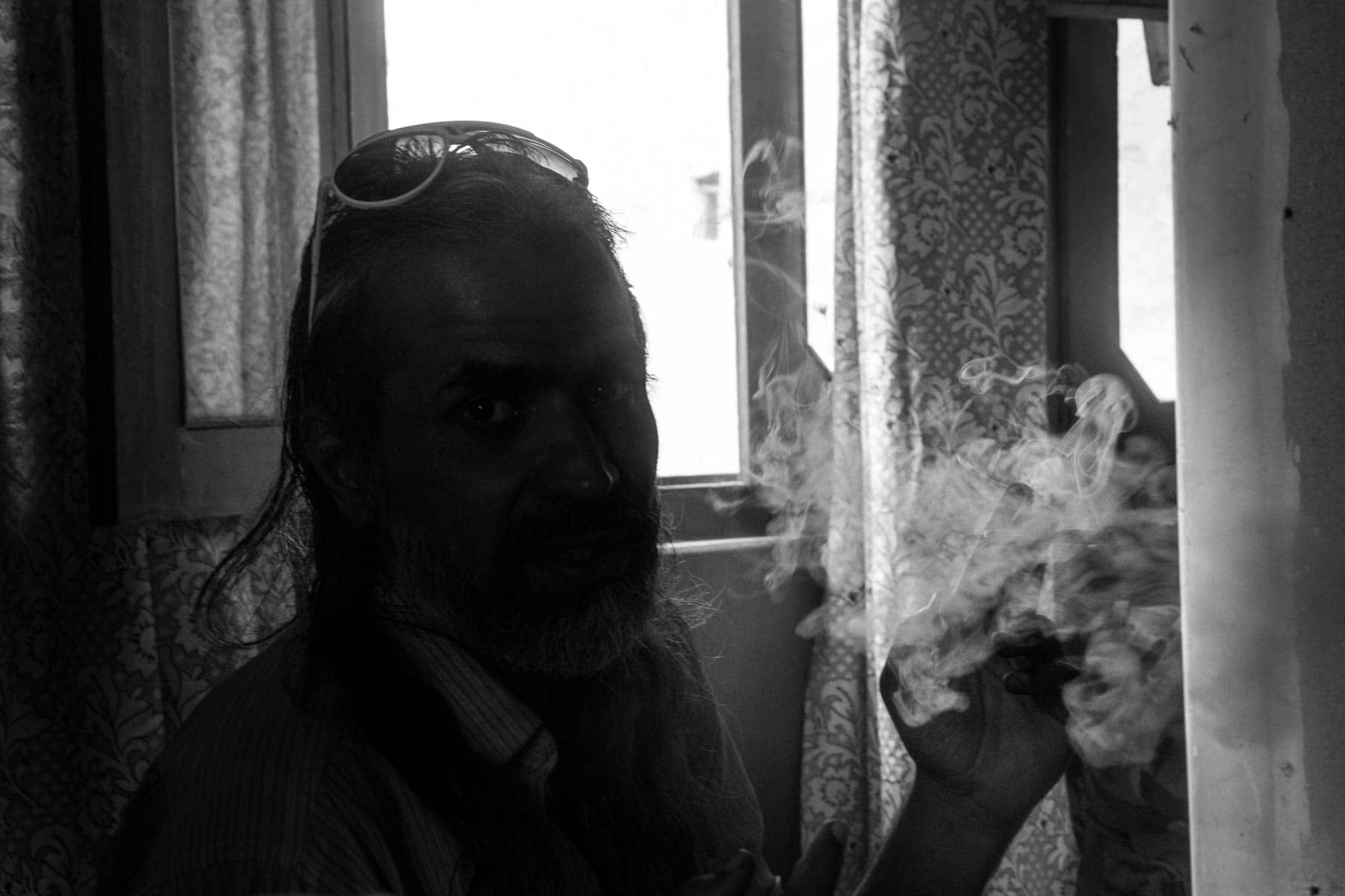 The hippie smoking with the stoners in Hunza, Pakistan