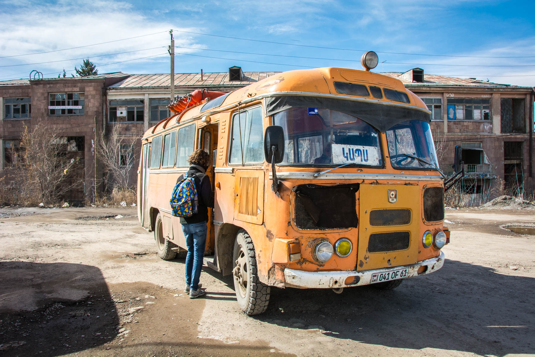 An old orange soviet bus in Gyumri, Armenia