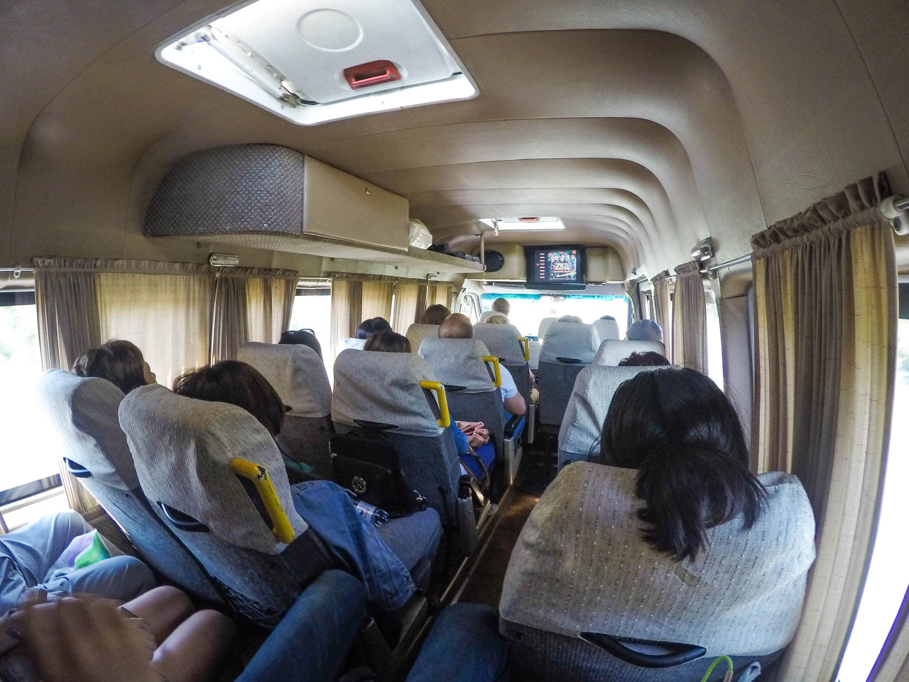 The inside of a marshrutka driving through the Kazakhstan - Kyrgyzstan border crossing at Kordai