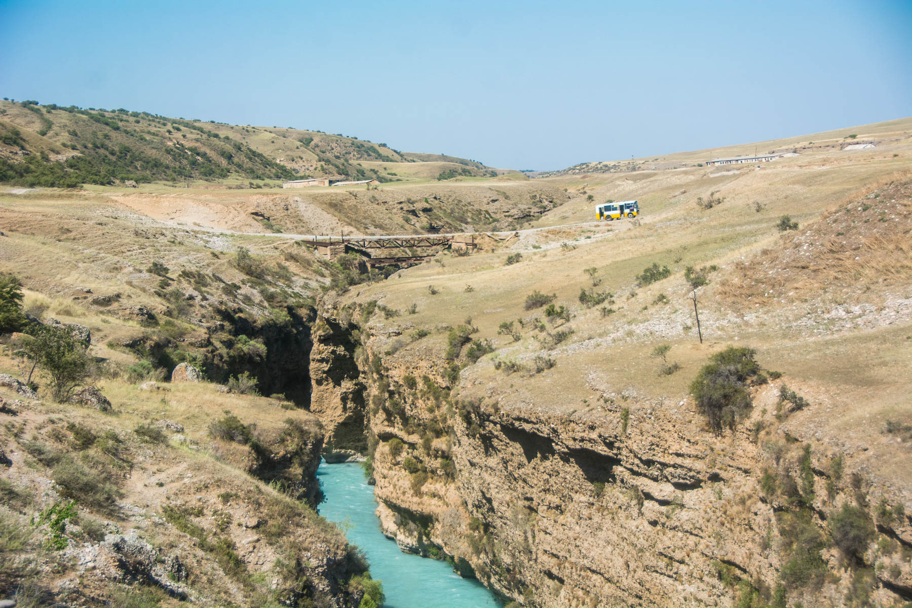Soviet bus and the rushing Aksu river in Kazakhstan - Lost With Purpose