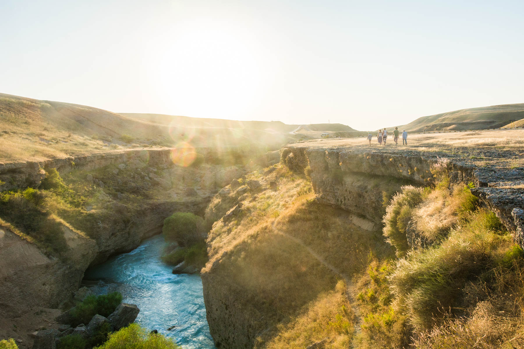 The glacial waters of the Aksu river threading through a canyon at sunset - Lost With Purpose