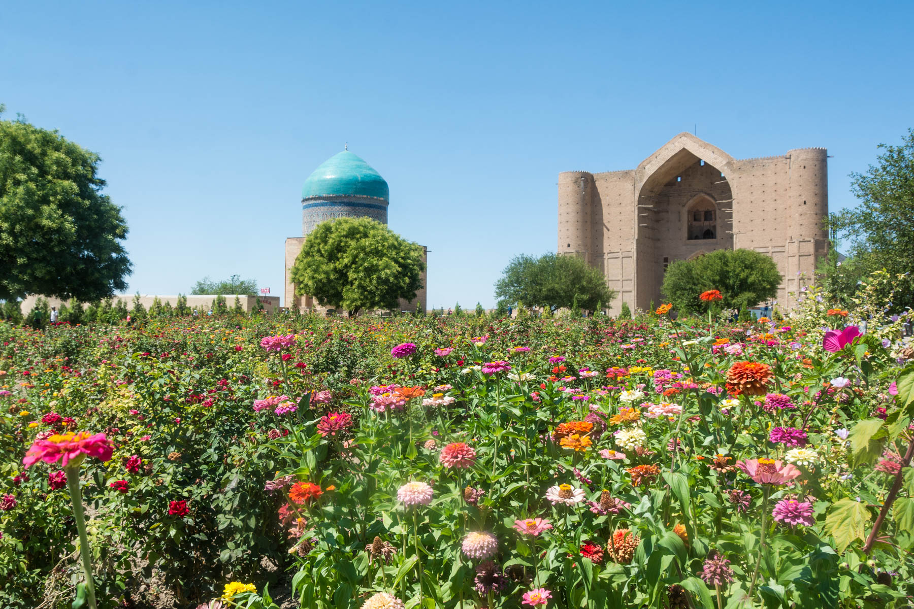 Flowers at the Khoja Ahmed Yasawi mosque in Turkestan, Kazakhstan - Lost With Purpose