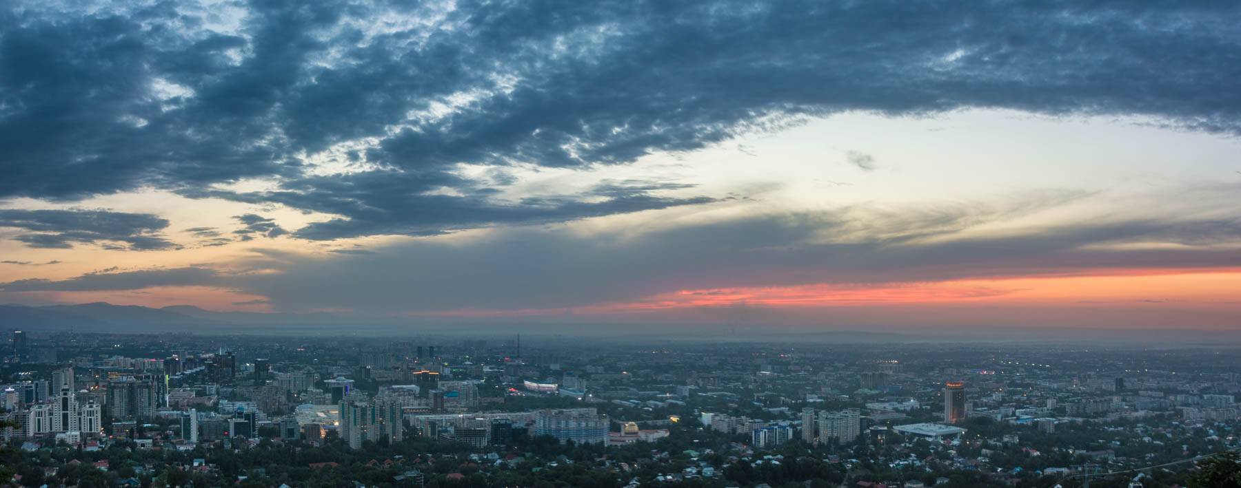A panoramic sunset view of Almaty, Kazakhstan - Lost With Purpose