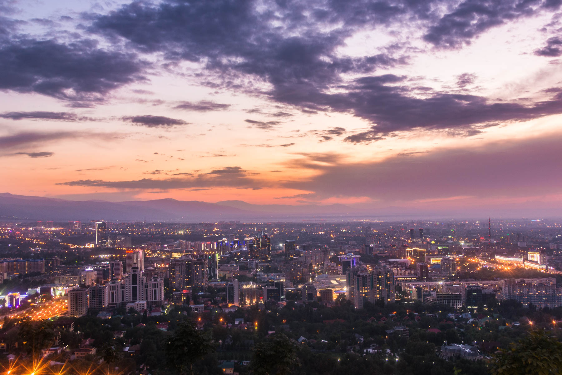 The Almaty skyline as seen from Kok Tobe at sunset - Lost With Purpose
