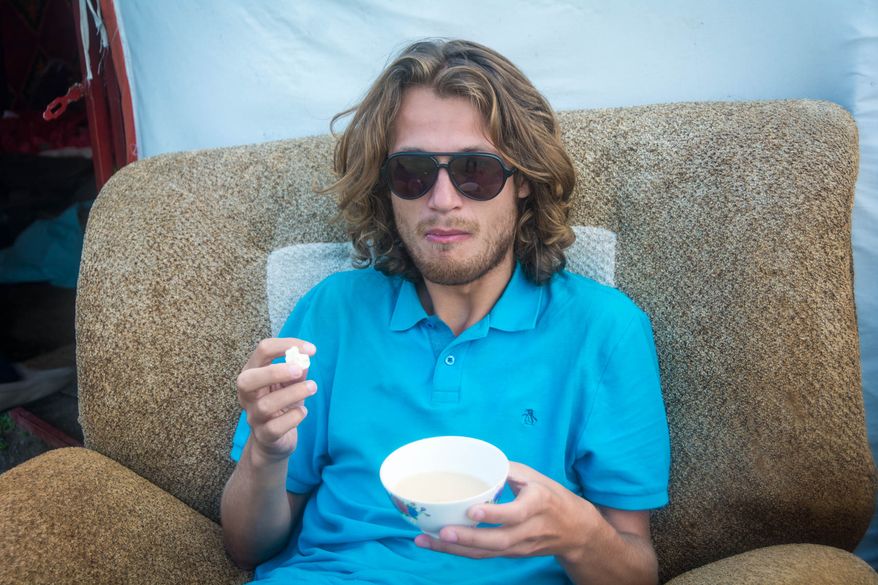 Sebastiaan does not enjoy the weird milk Kazakh snacks - Lost With Purpose
