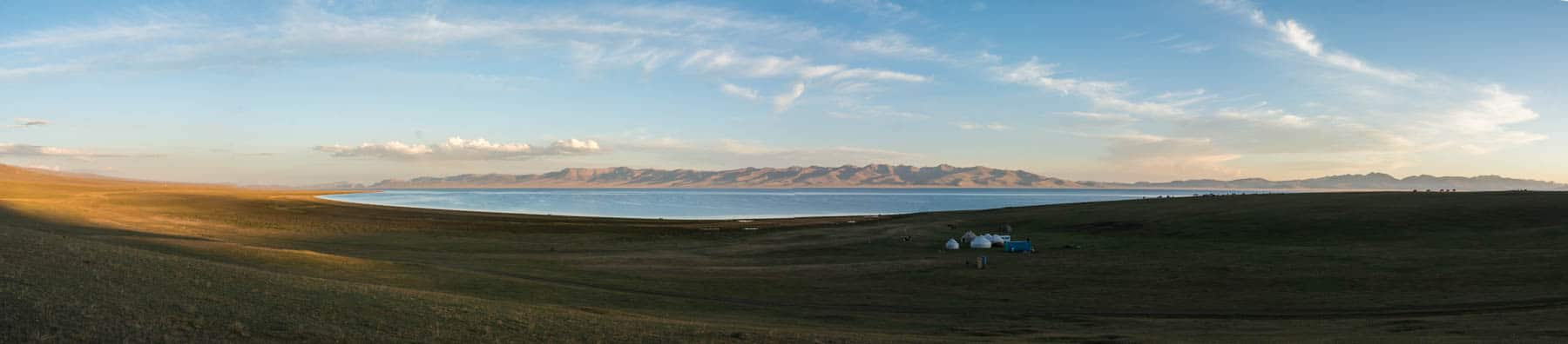 Sunset over a yurt camp at Song Kul lake in Kyrgyzstan - Lost With Purpose