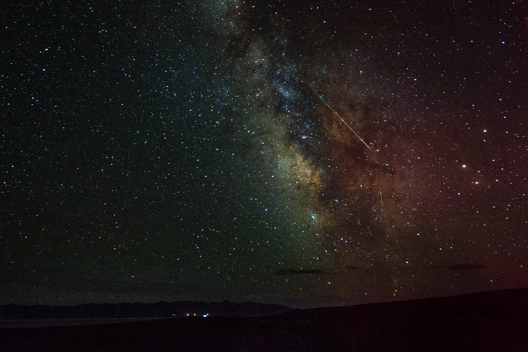 The milky way and a shooting star over Song Kul lake in Kyrgyzstan - Lost With Purpose