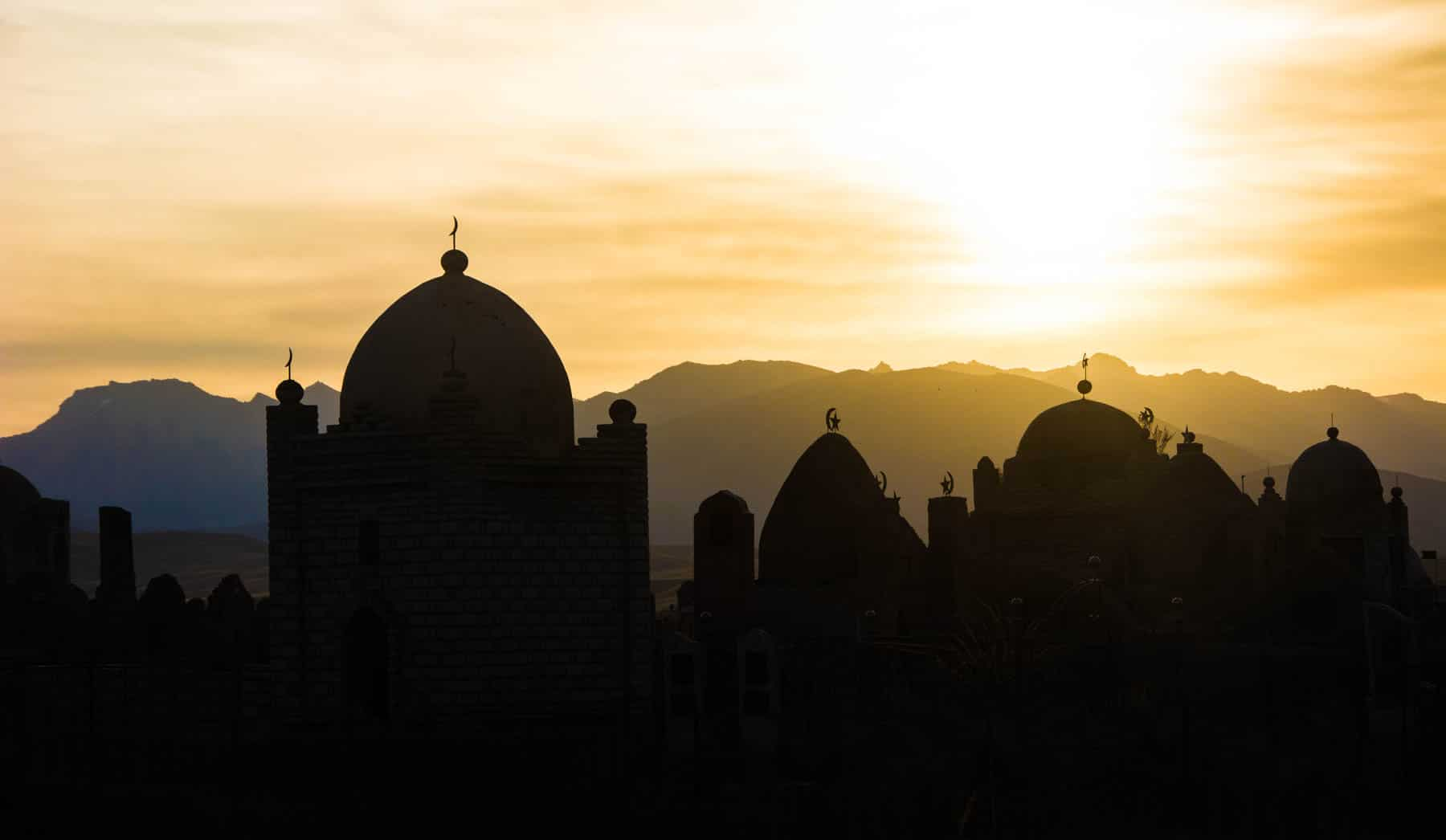 Sunrise over an Islamic cemetery in Kyzart, Kyrgyzstan - Lost With Purpose