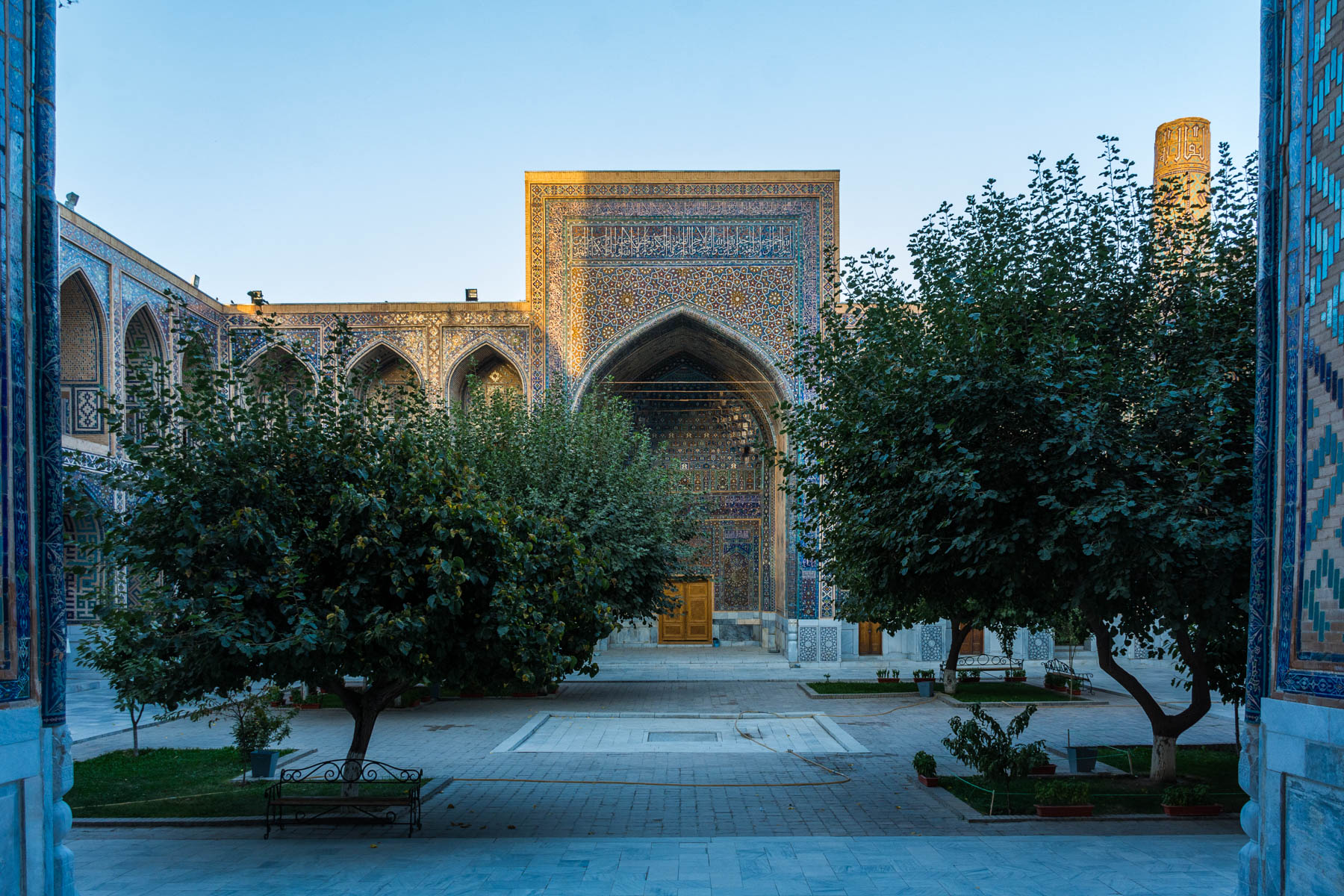 Why you need to see sunrise in Uzbekistan - A madrasa at the Registan at sunrise - Lost With Purpose