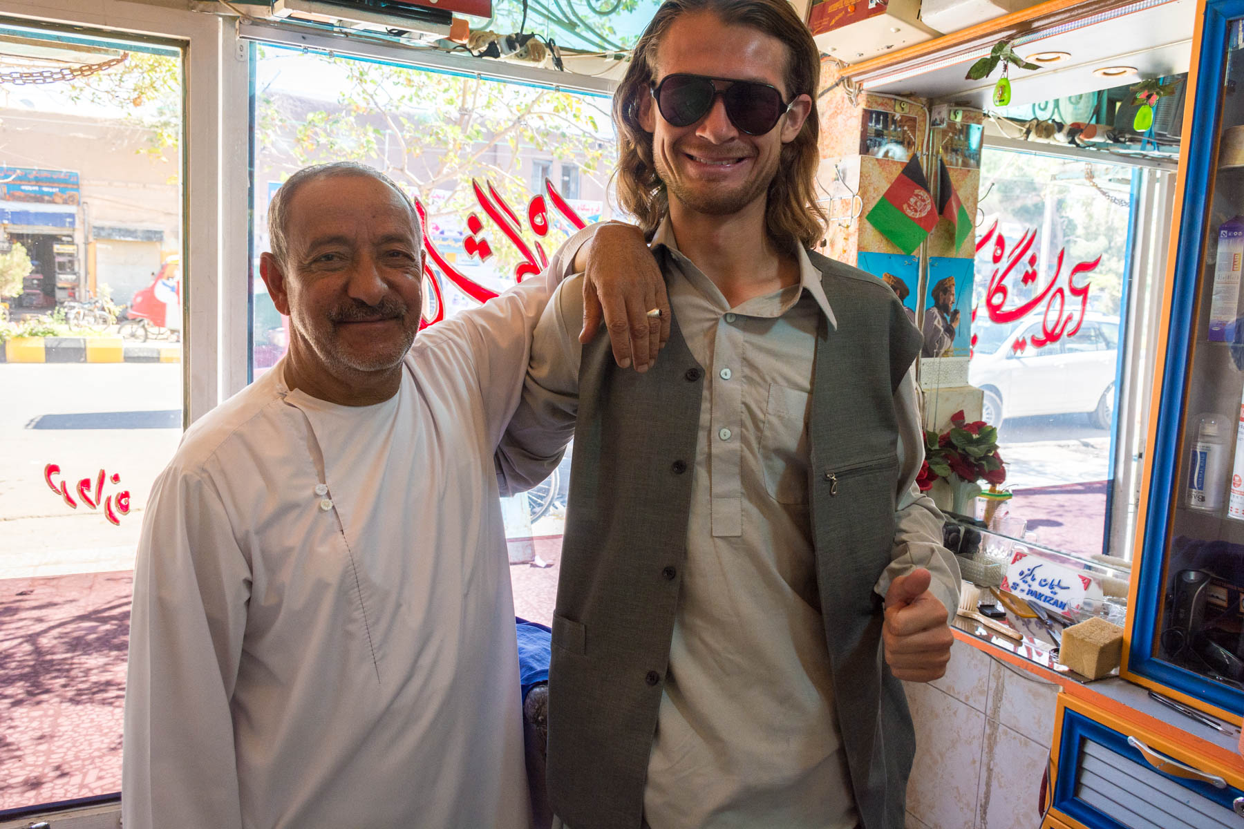 Sebastiaan posing with a friendly barber in Herat, Afghanistan - Lost With Purpose
