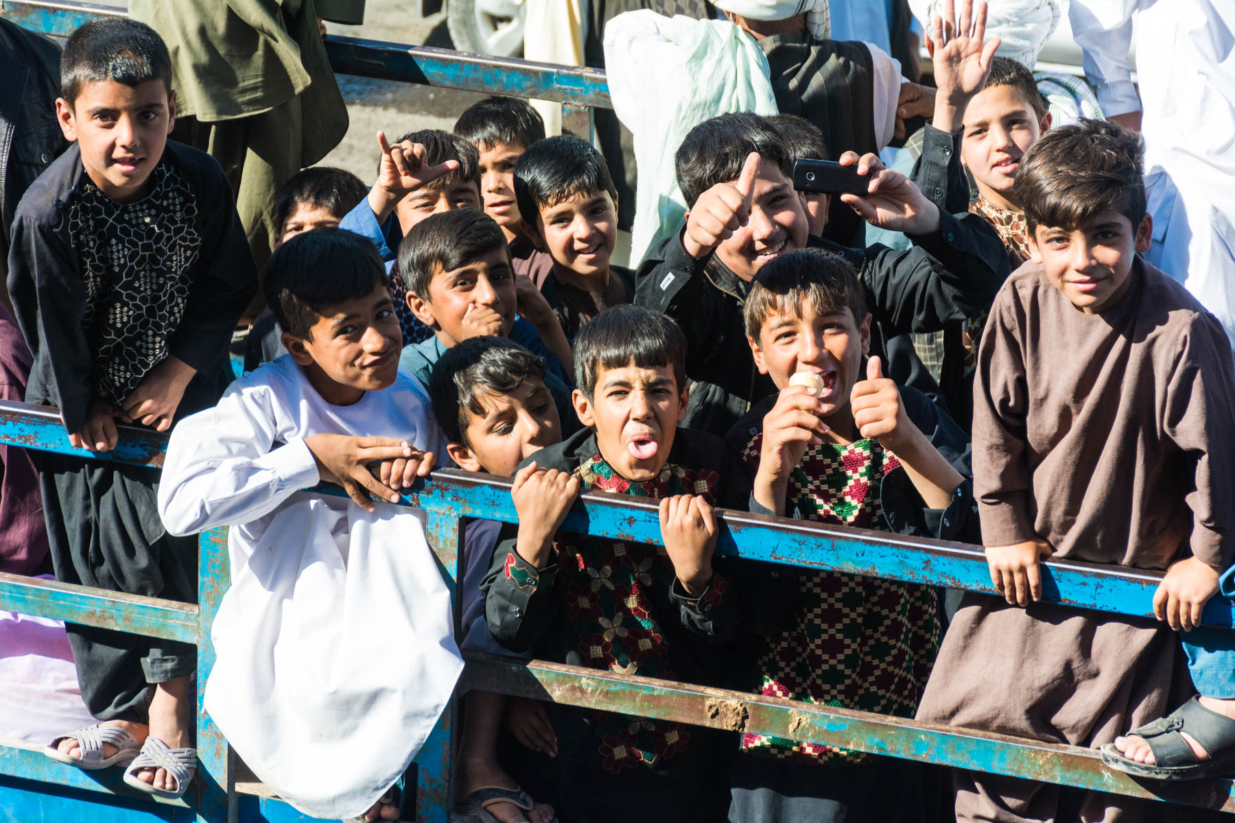 Playful Afghan boys in the back of a truck in Herat, Afghanistan - Lost With Purpose