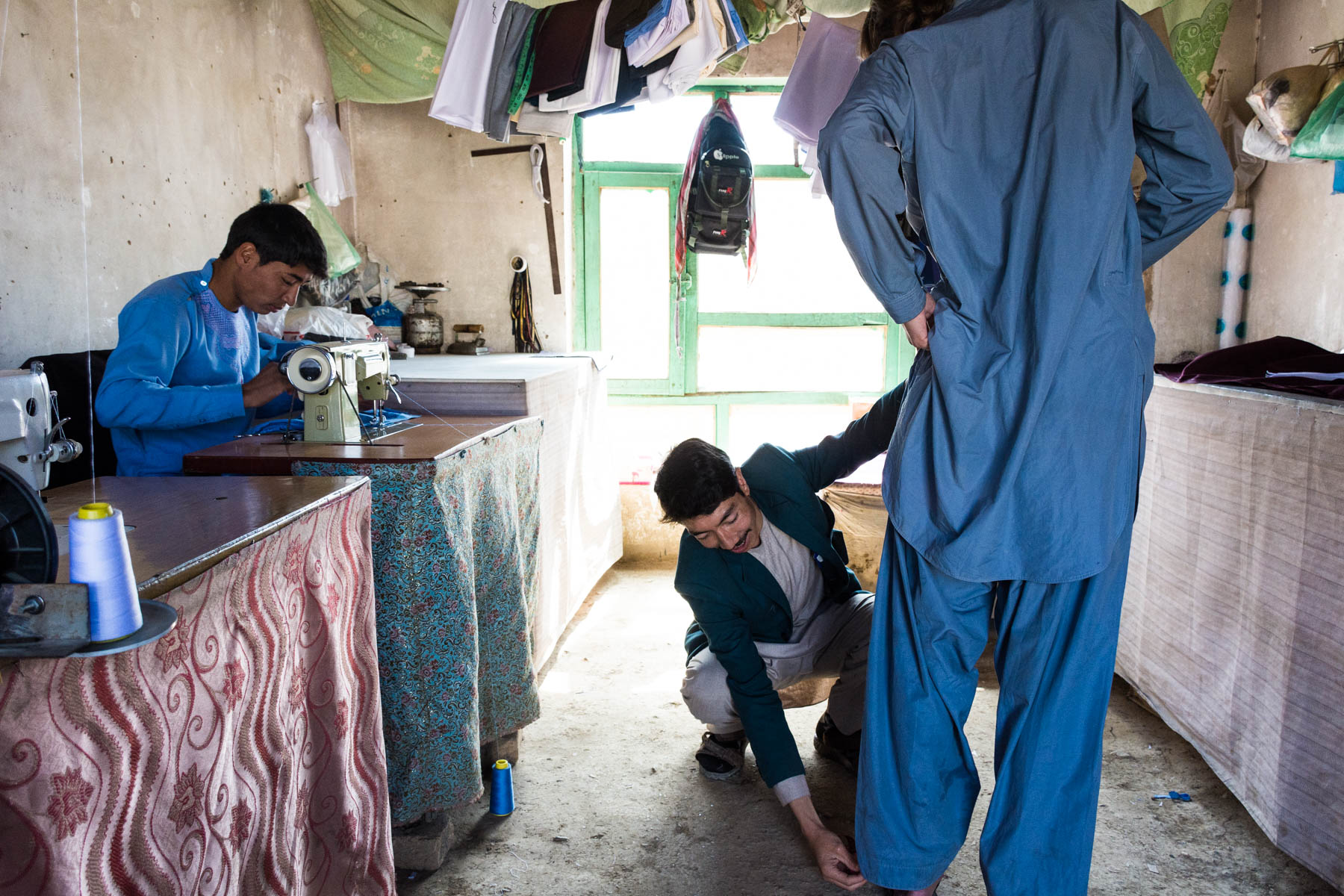 Getting measured for a new shalwar kameez by a tailor in Bamiyan,  Afghanistan - Lost