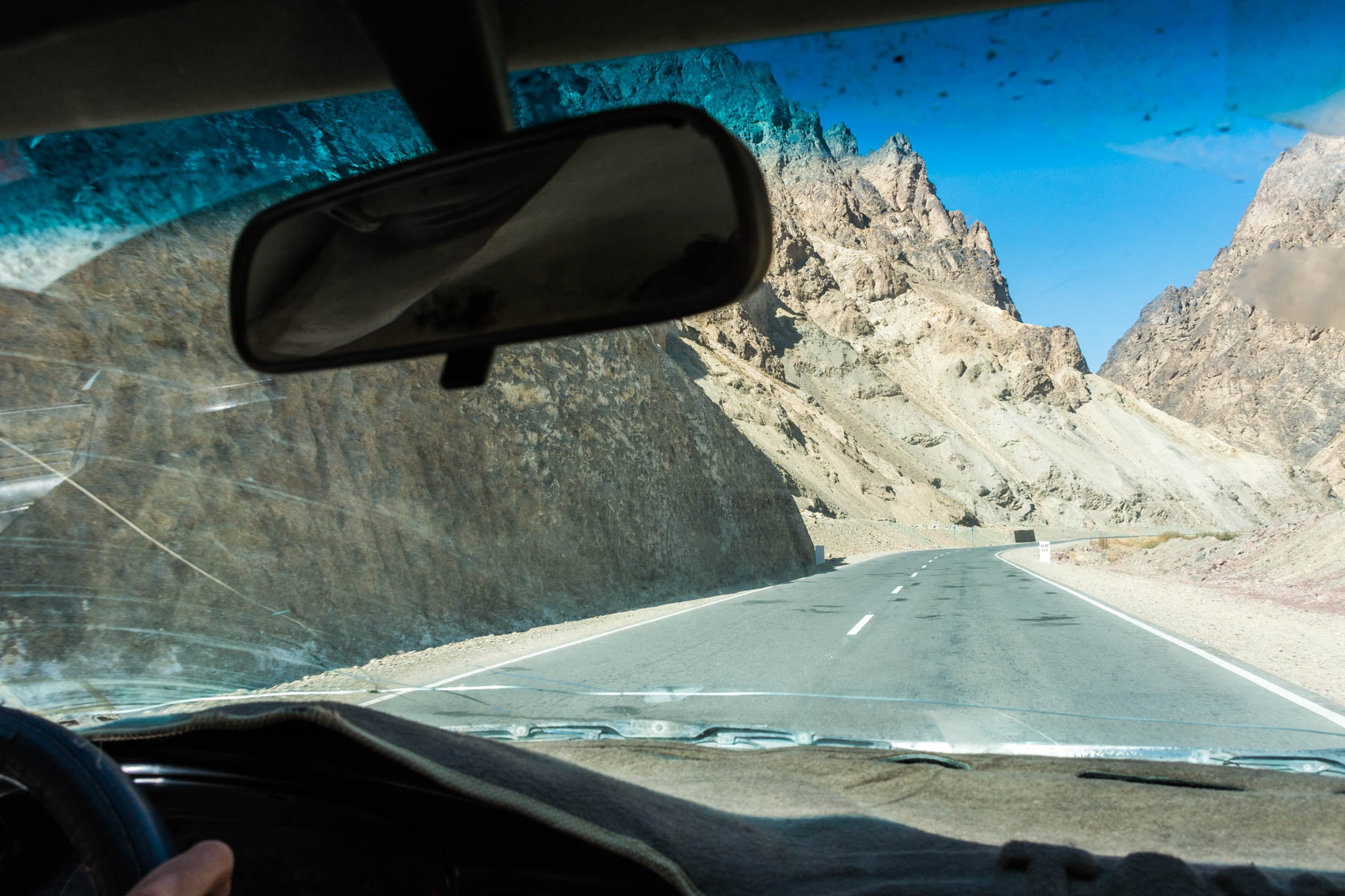 Woman driving on the surprisingly good roads near Bamiyan, Afghanistan