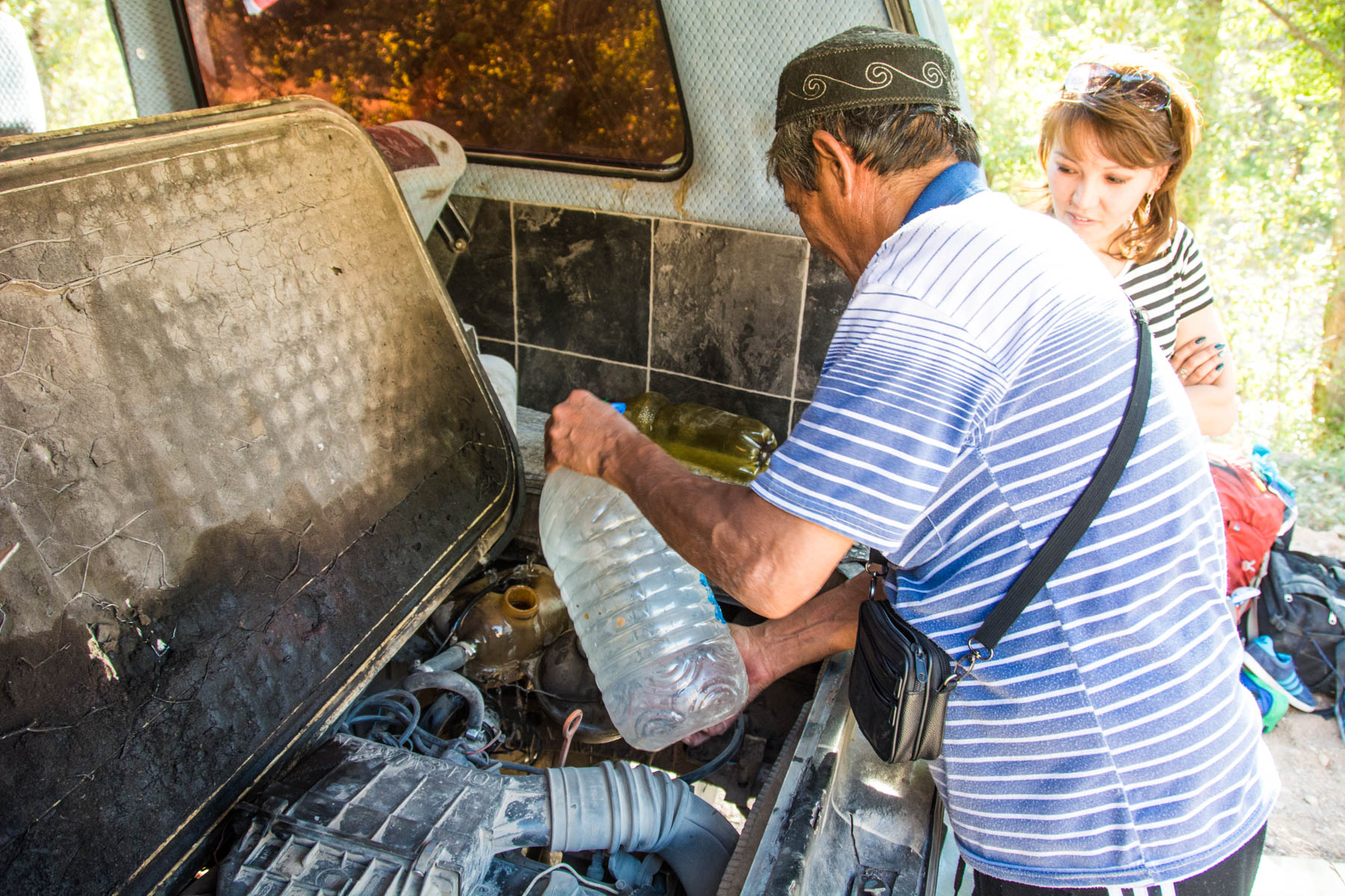 Pouring water into the van's engine on the way to Min Kush, Kyrgyzstan - Lost With Purpose
