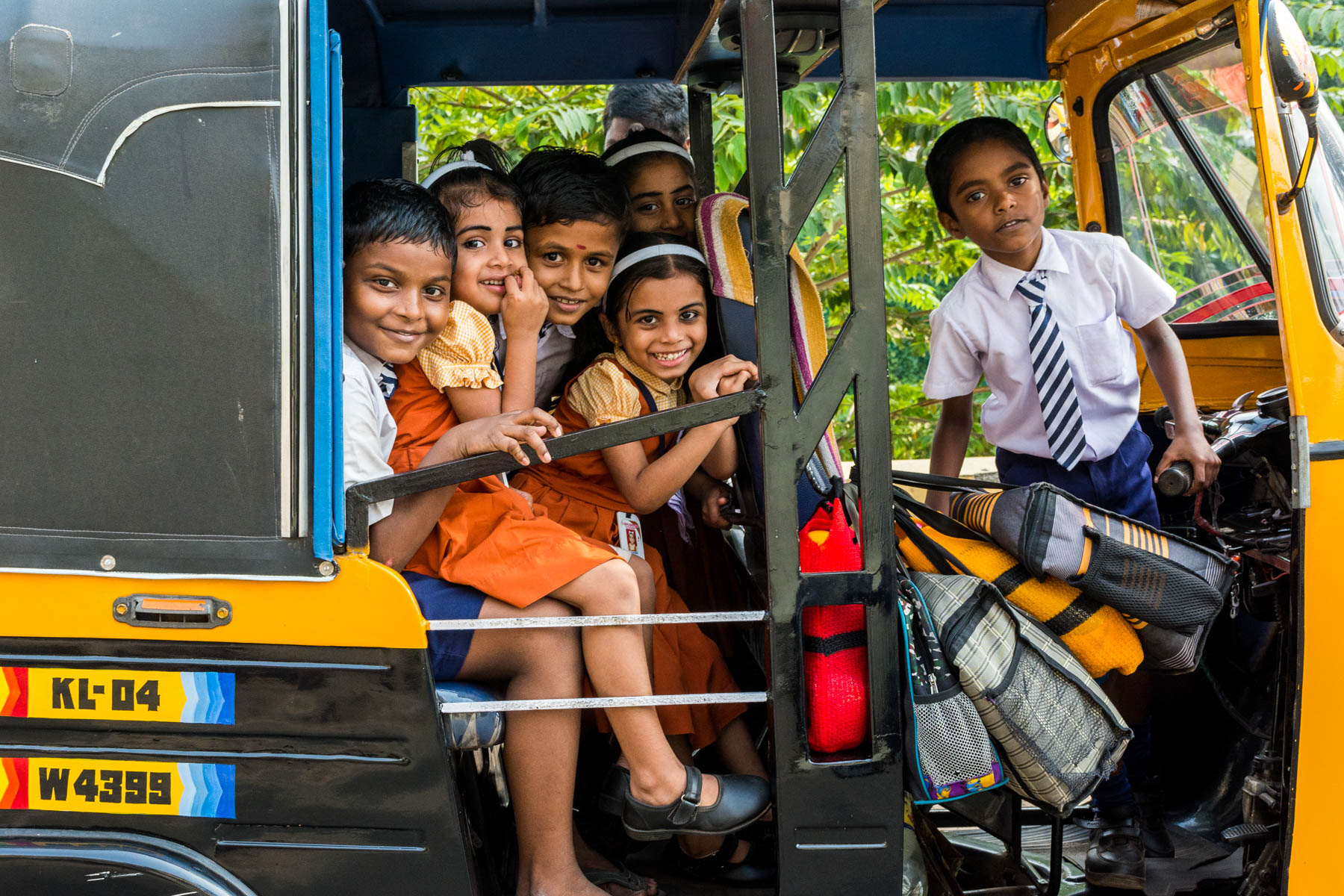 School children in an auto rickshaw in Alleppey, India - Lost With Purpose