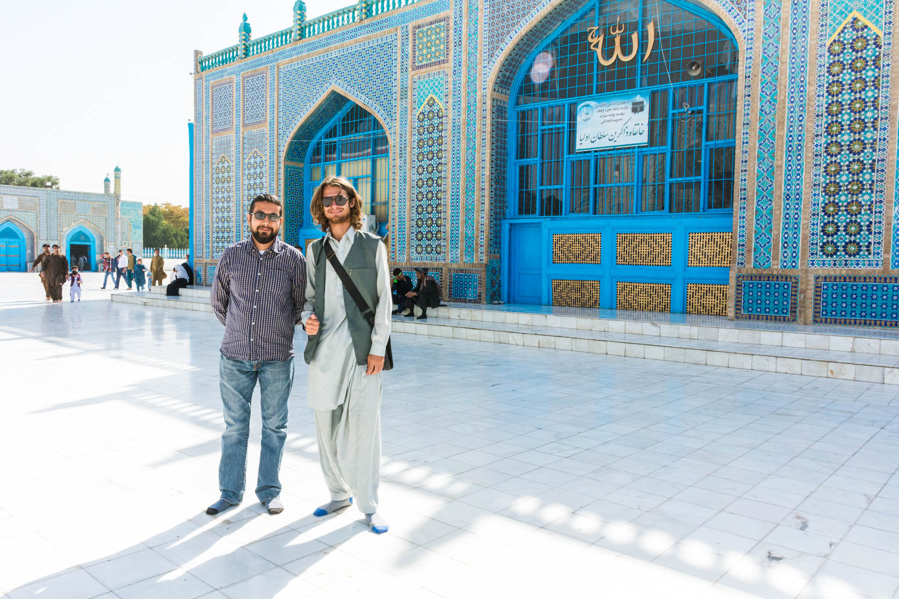 Two men standing in front of the Blue Mosque in Mazar-i-Sharif, Afghanistan