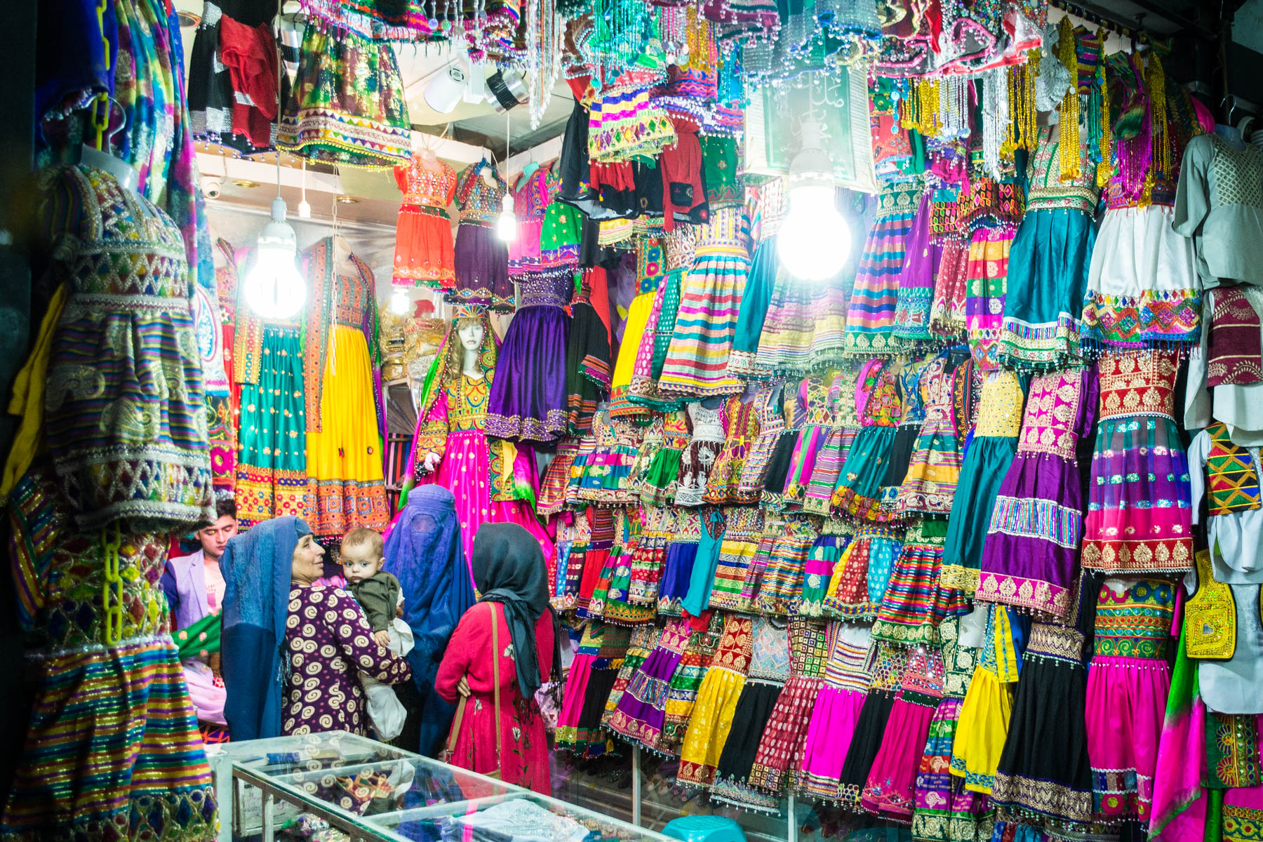 Women in burqas shopping in Mazar-i-Sharif, Afghanistan - Lost With Purpose
