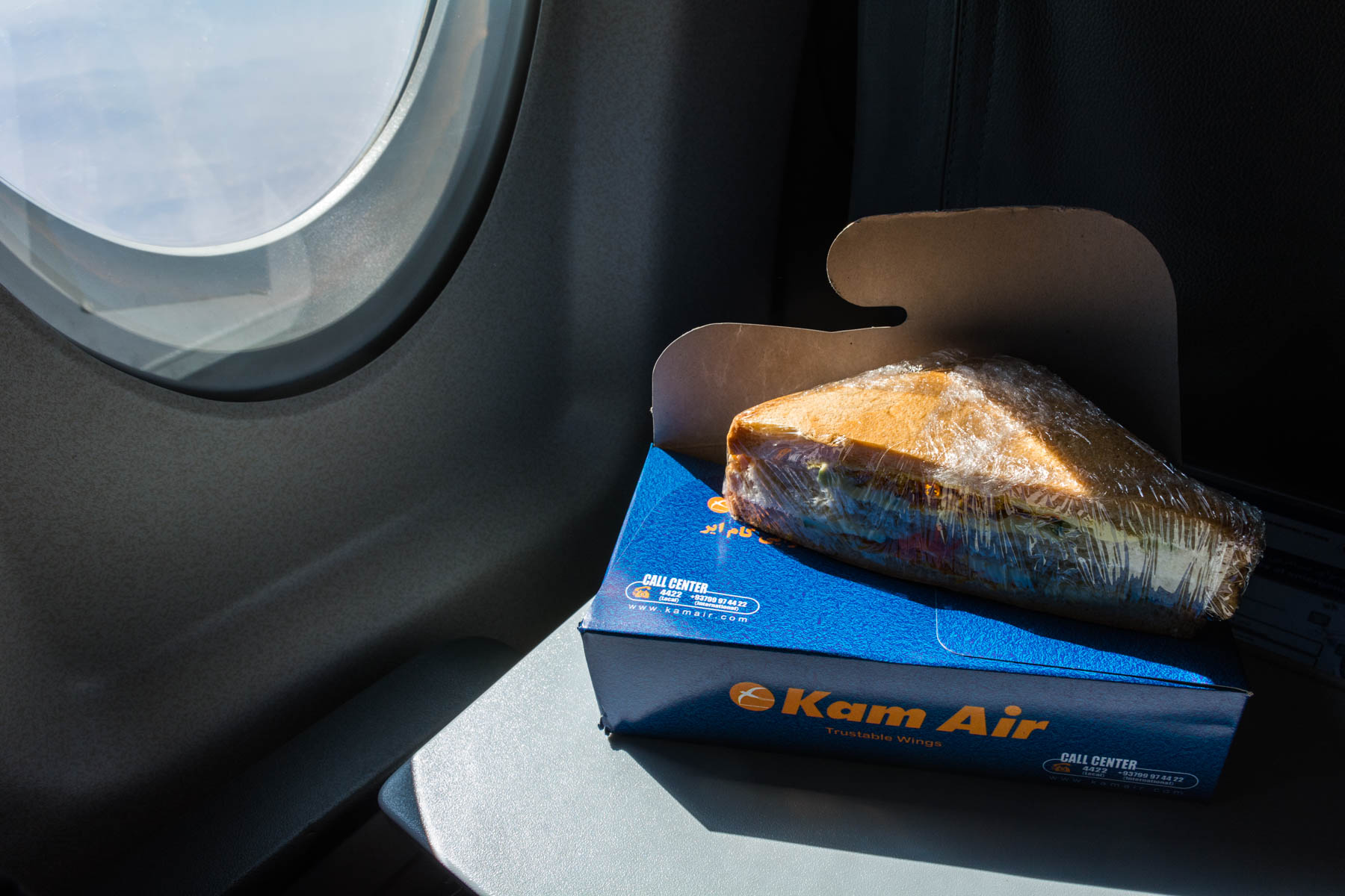 "Airline food in Afghanistan: the grossly ubiquitous dried chicken sandwich ""food"" served on all Kam Air flights - Lost With Purpose"