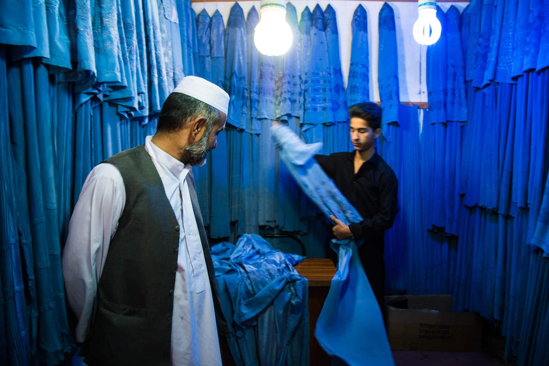 The owner of a burqa shop in Herat, Afghanistan - Lost With Purpose