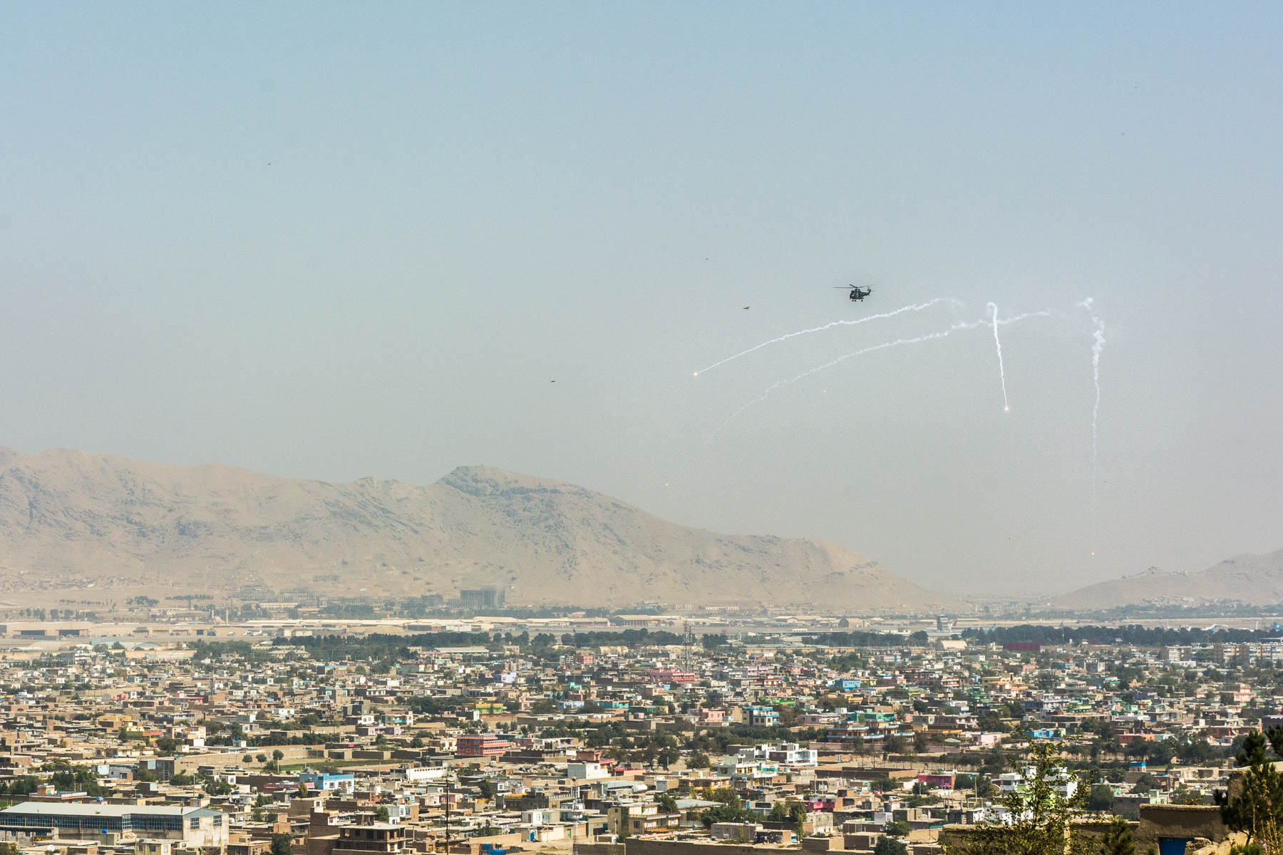 A military helicopter patrolling the skies of Kabul, Afghanistan